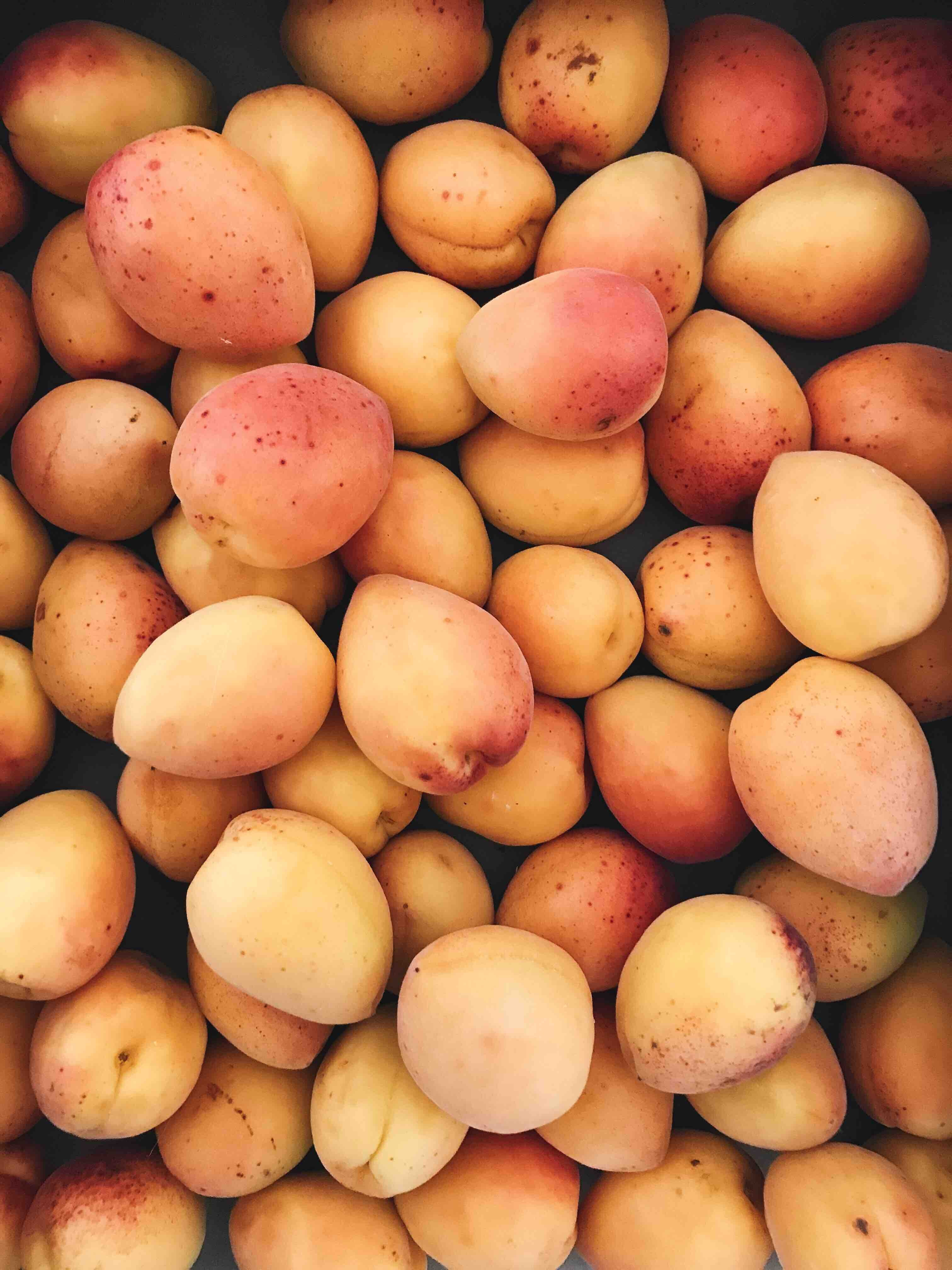 Pile of fresh apricots at a produce market