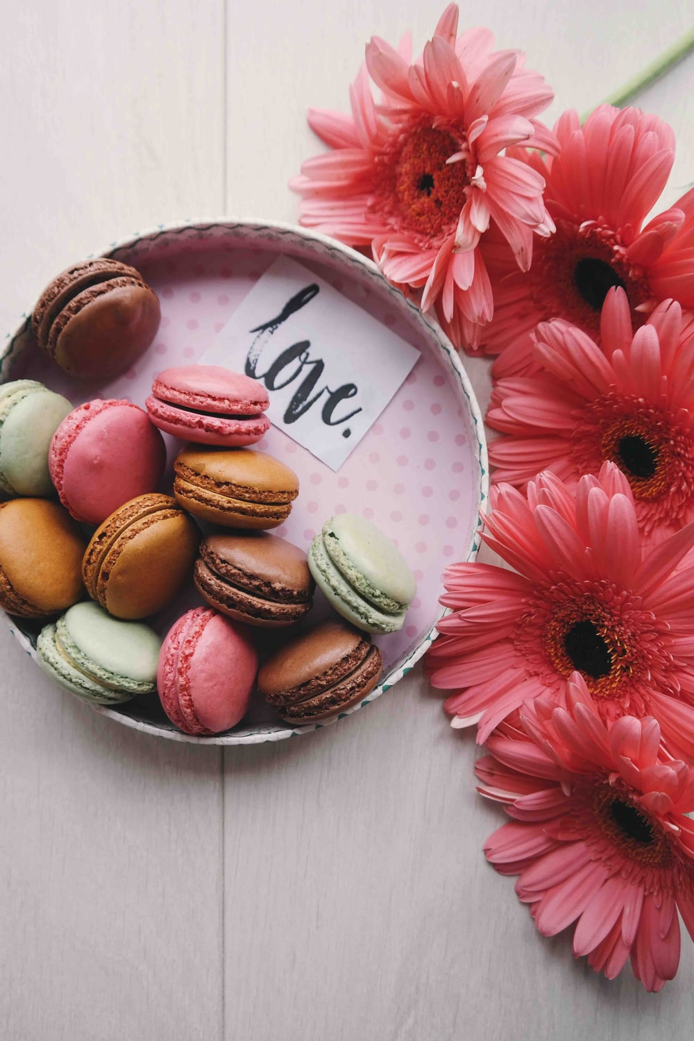 macaroons on a tray with the word 'love'