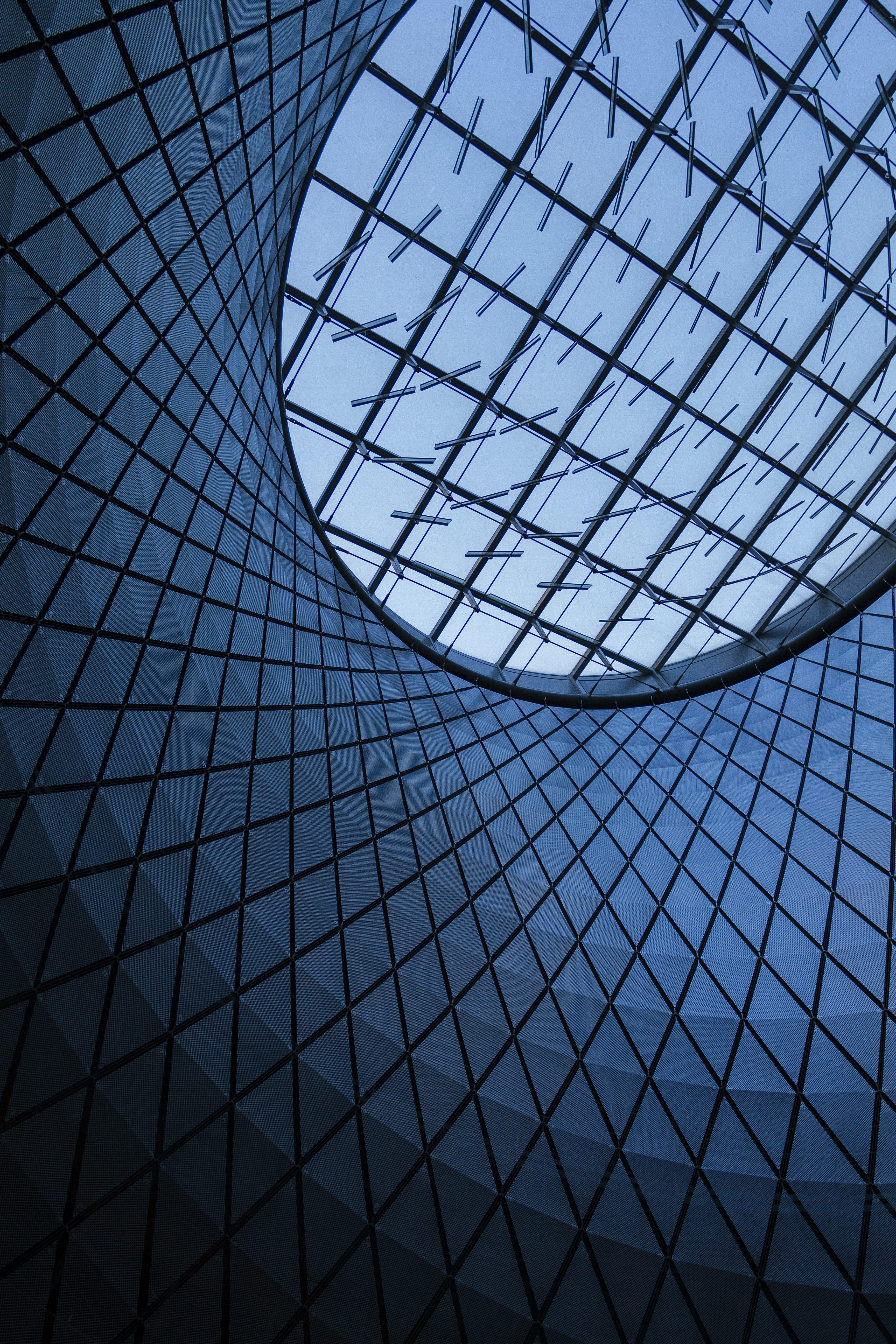 A modern round facade with a large skylight in the interior of the Fulton Center