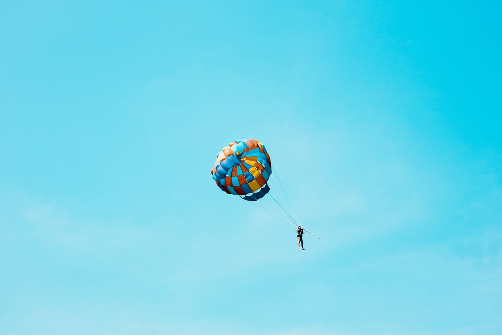 person using parachute on sky