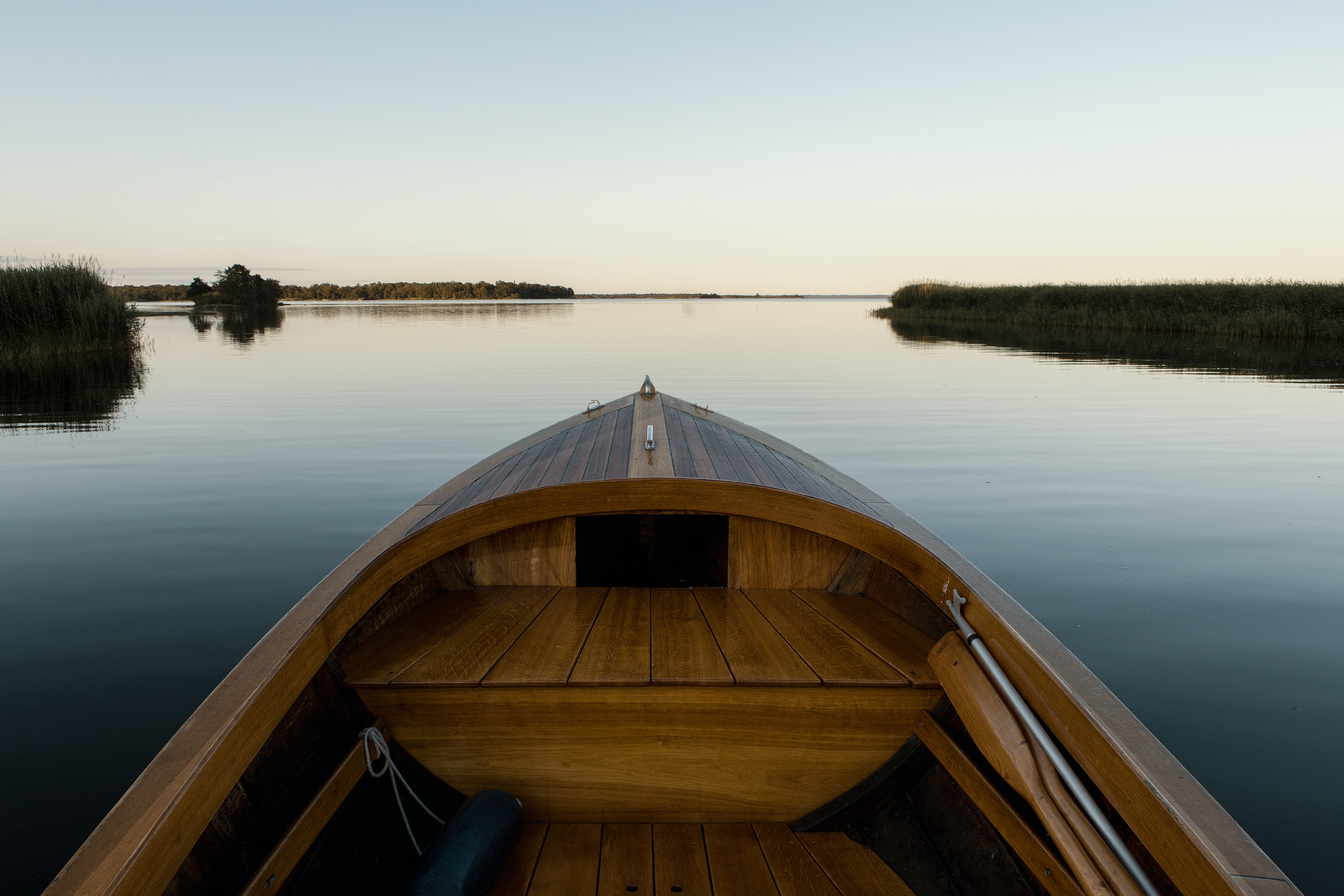 landscape photography of brown boat surrounded by body of water during daytime
