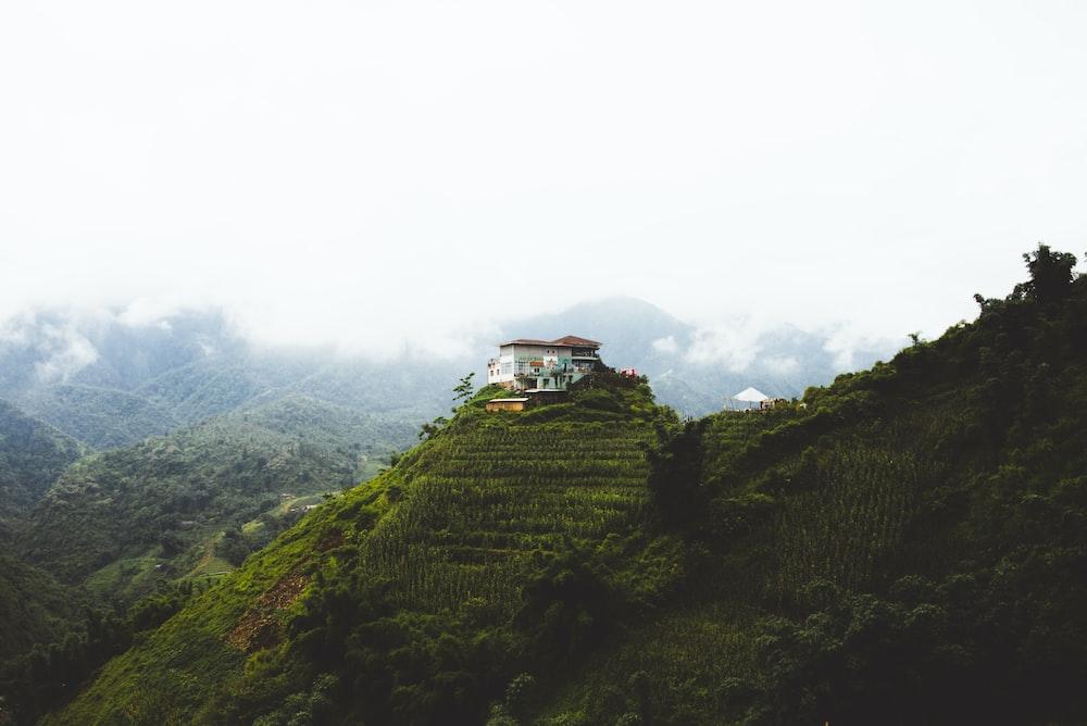 white concrete house on mountain during daytime
