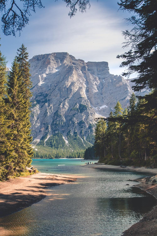 white mountain near body of water