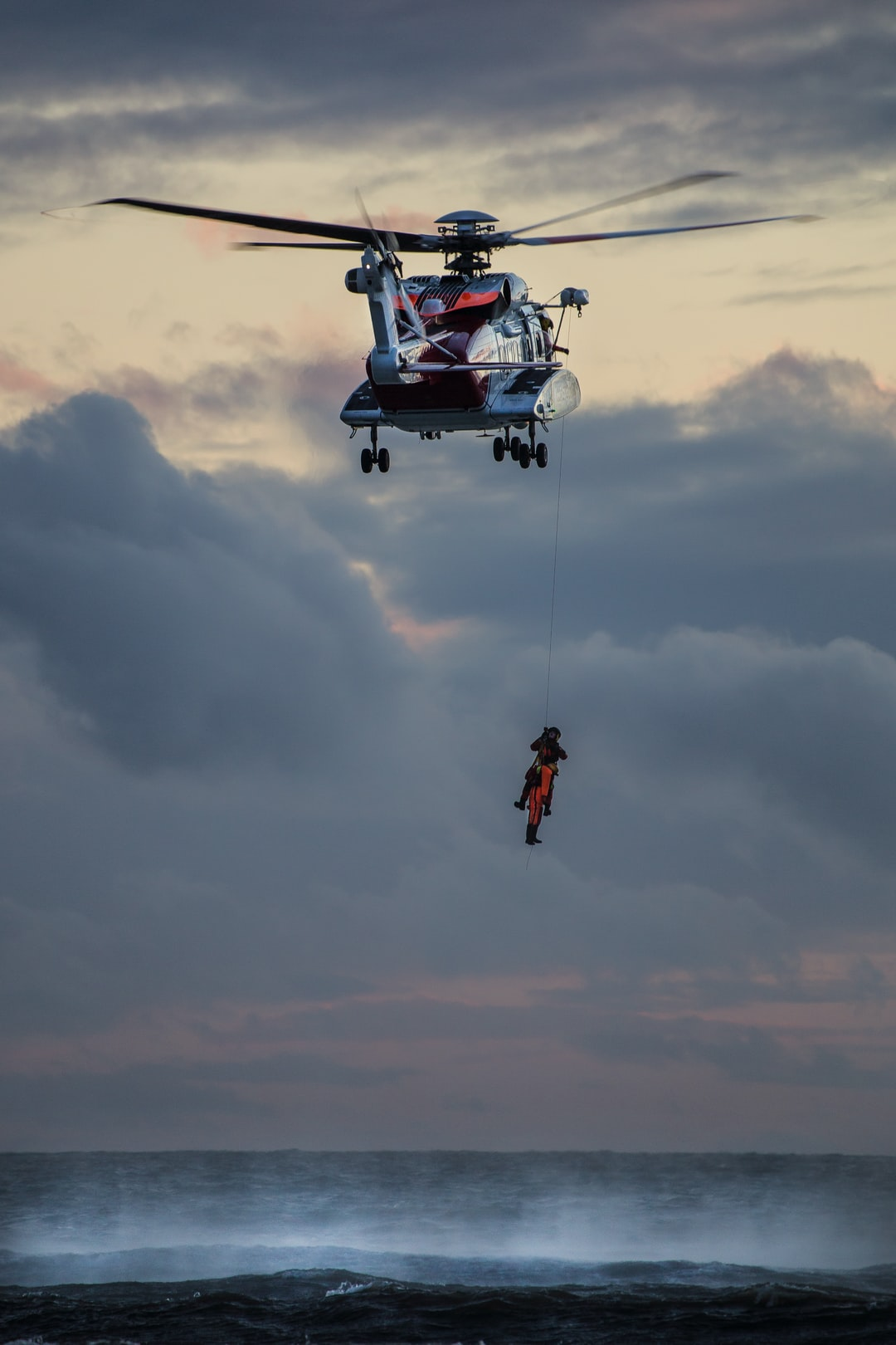 I went down to Dinas Dinlle beach near Caernarfon (North Wales) to try some long exposures of the waves and clouds. To my surprise a HM Coastguard training operation was taking place. In this photo you can see the winch-man and a dummy being lifted from the cold sea.