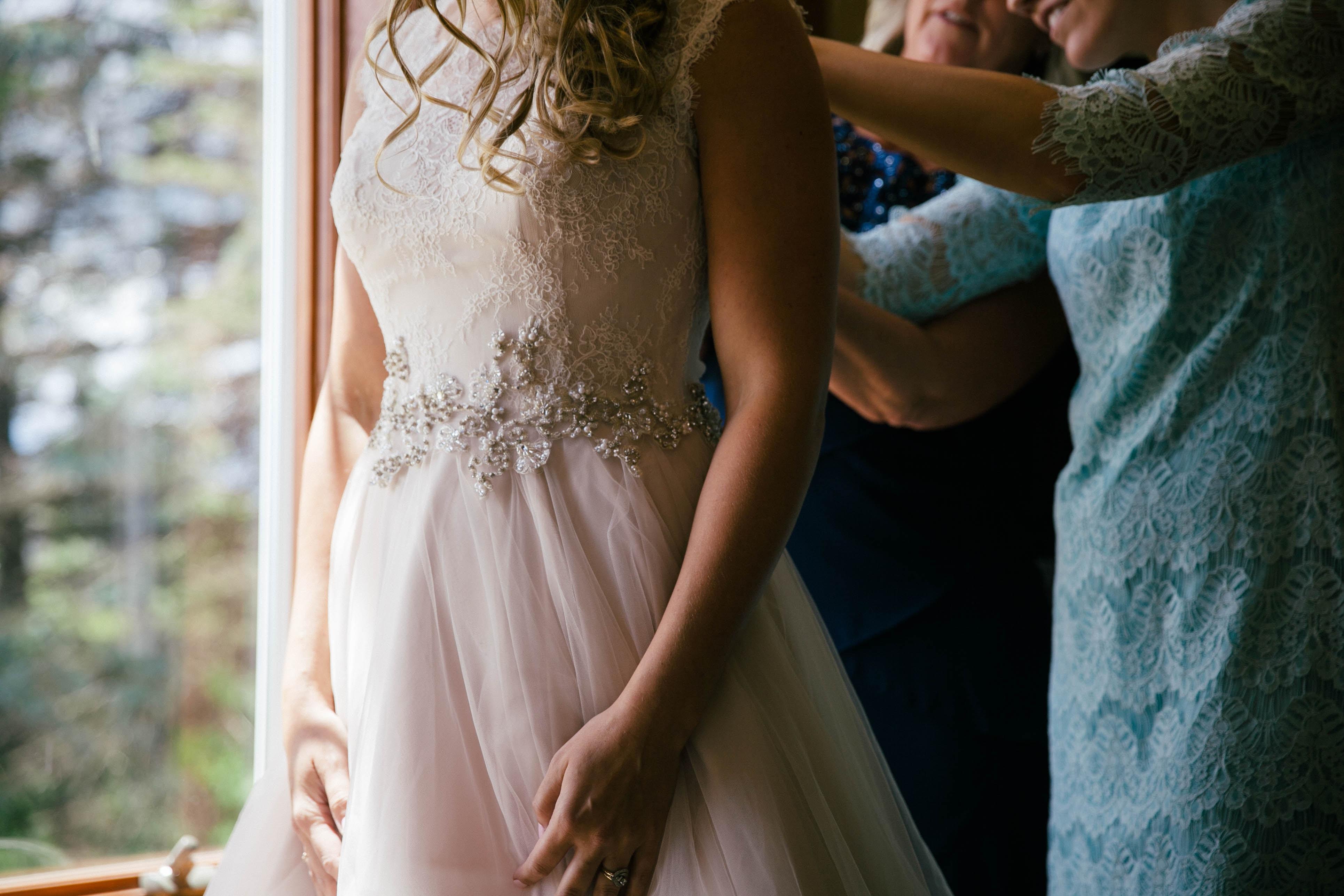 woman wearing white sleeveless wedding dress near tree