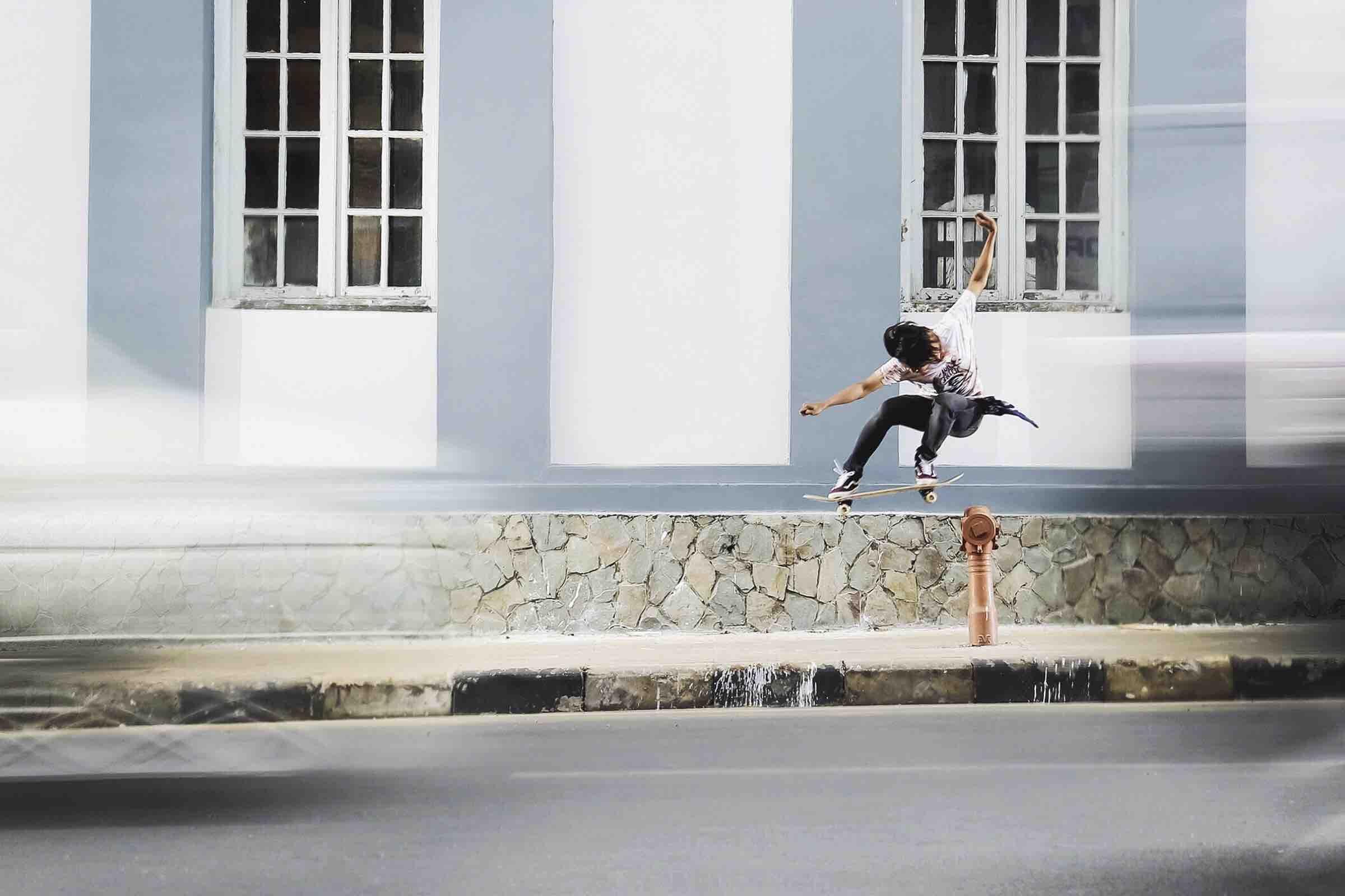 Skateboarder doing a skate trip on a city street