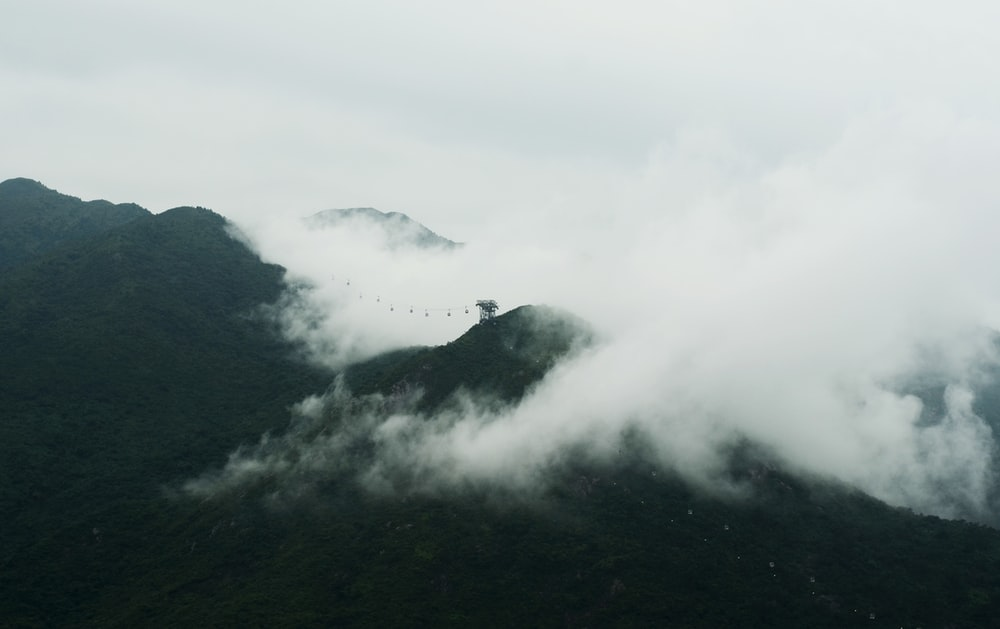 white clouds above brown mountains landscape photography