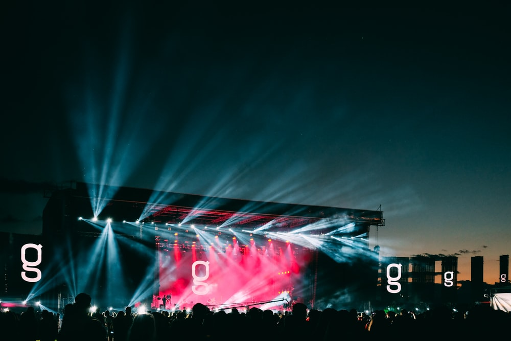 silhouette of people and stage lights during nighttime