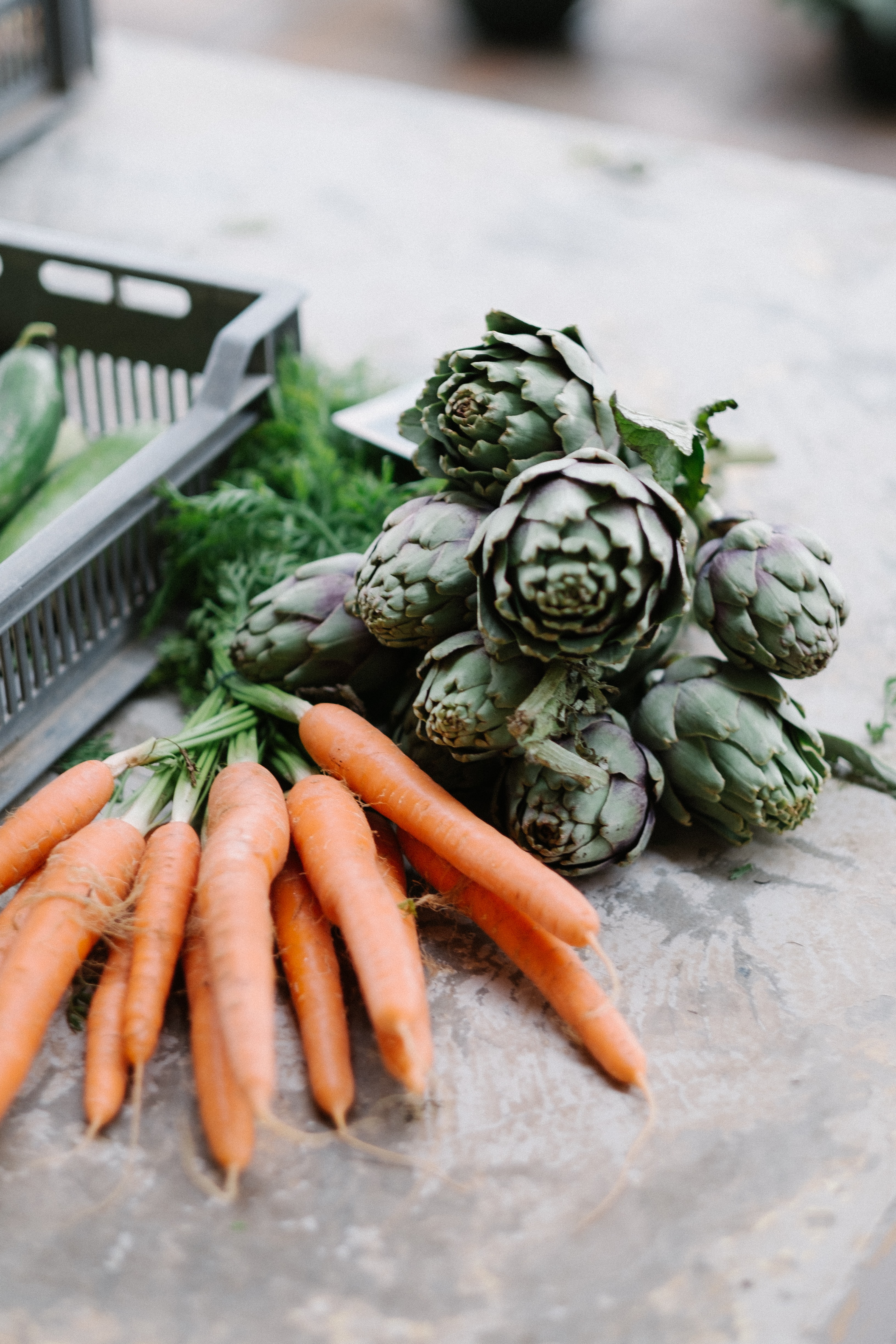 Artichoke, carrots, and fresh produce at the market ready to eat