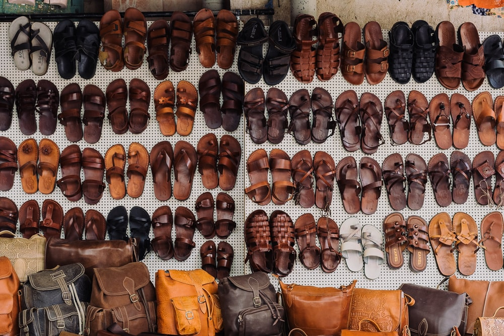 pairs of assorted sandal lot on white textile
