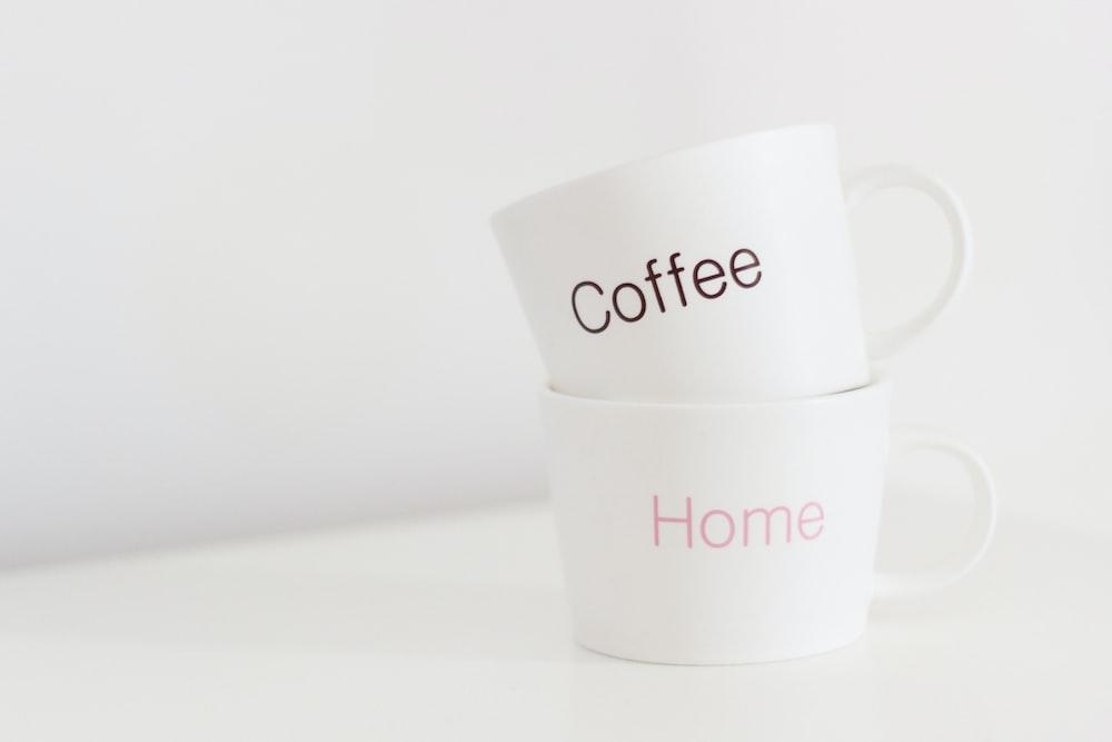 two white ceramic mugs