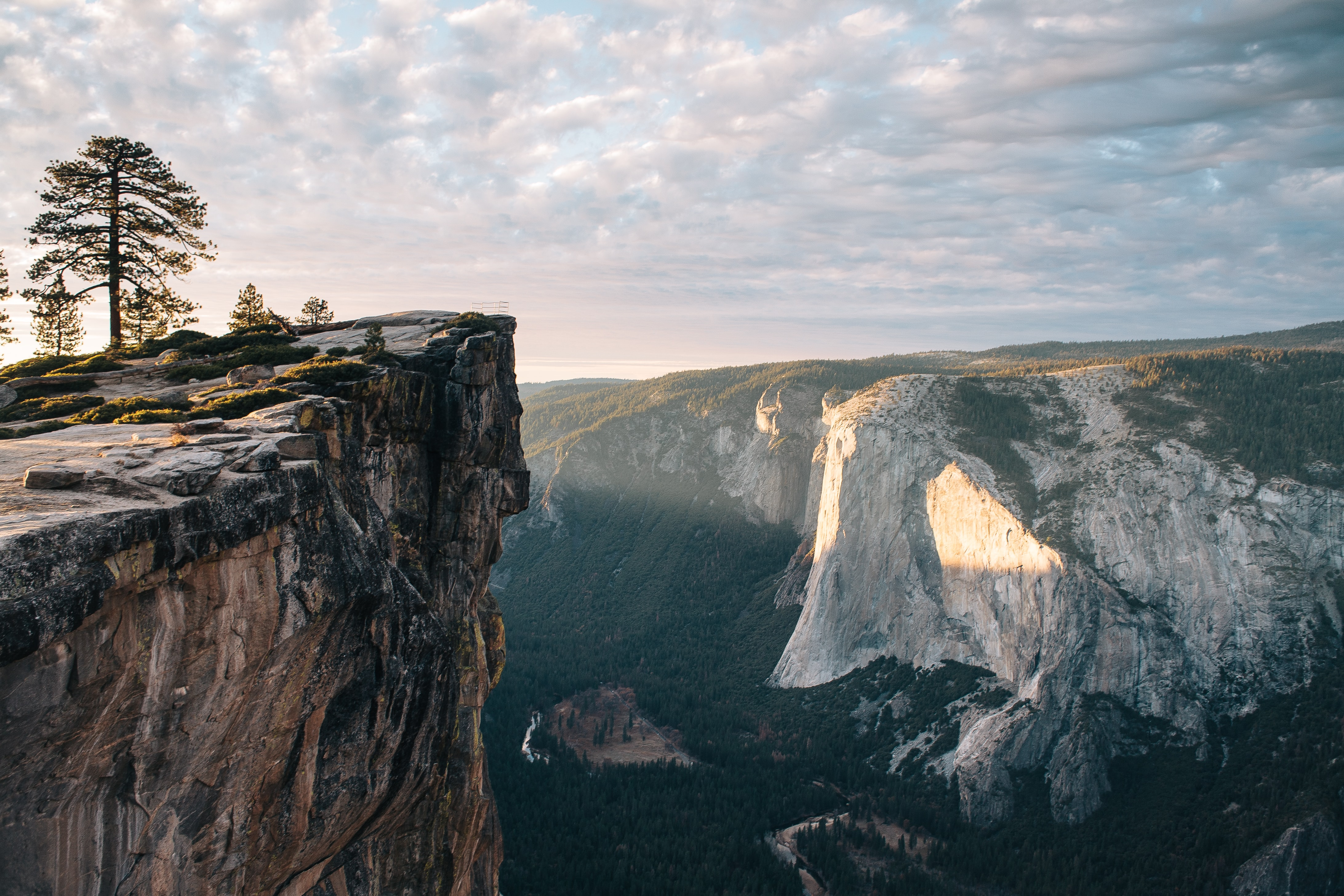 cliff overlooking mountain during daytime