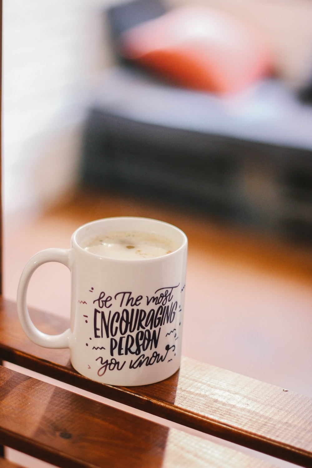 "A cup that says ""Be the most encouraging person."""