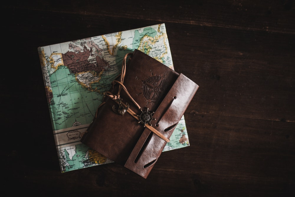 A leather journal and a travel diary as seen in Cologne.
