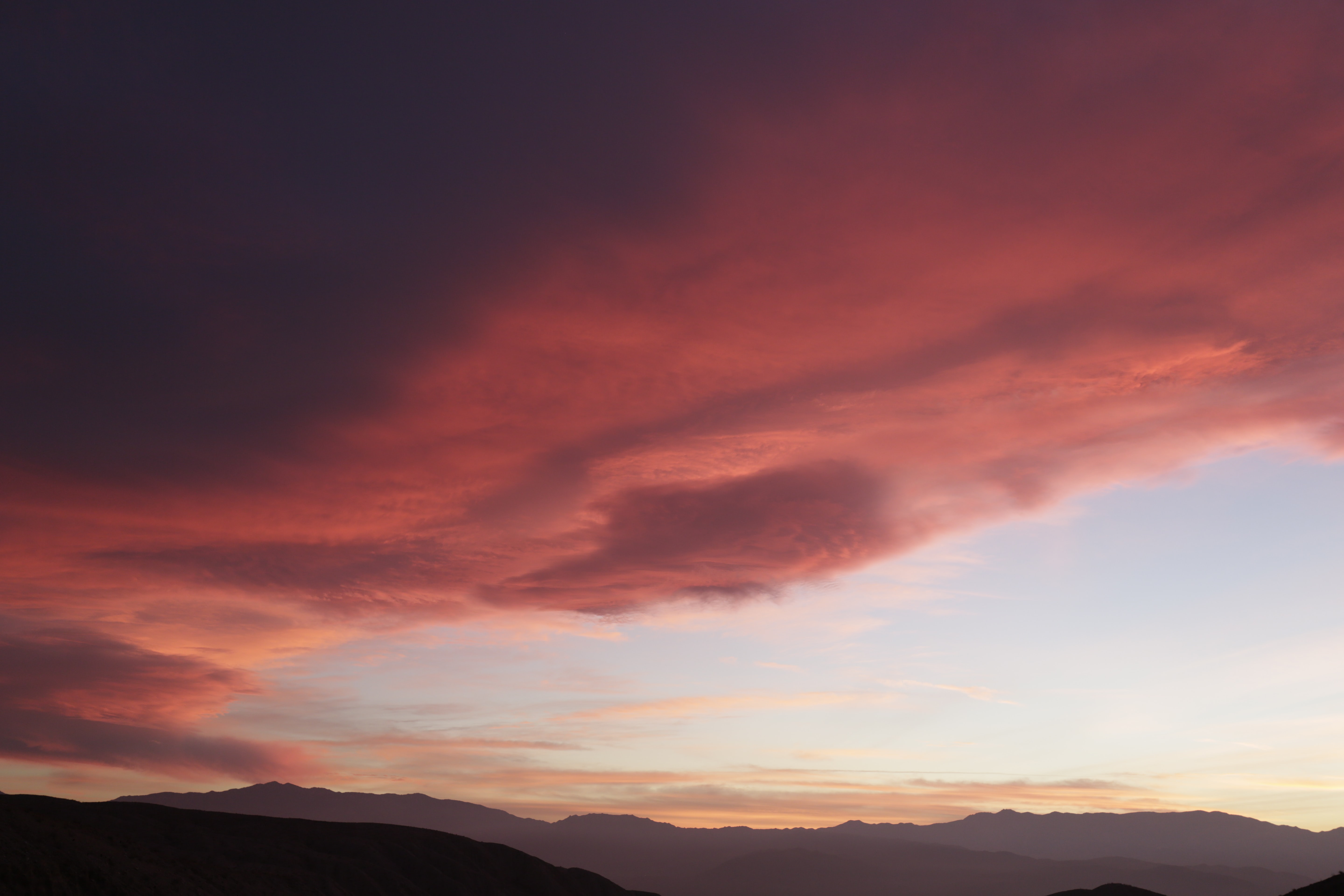 Colorful clouds in the Palm Desert sky at dusk