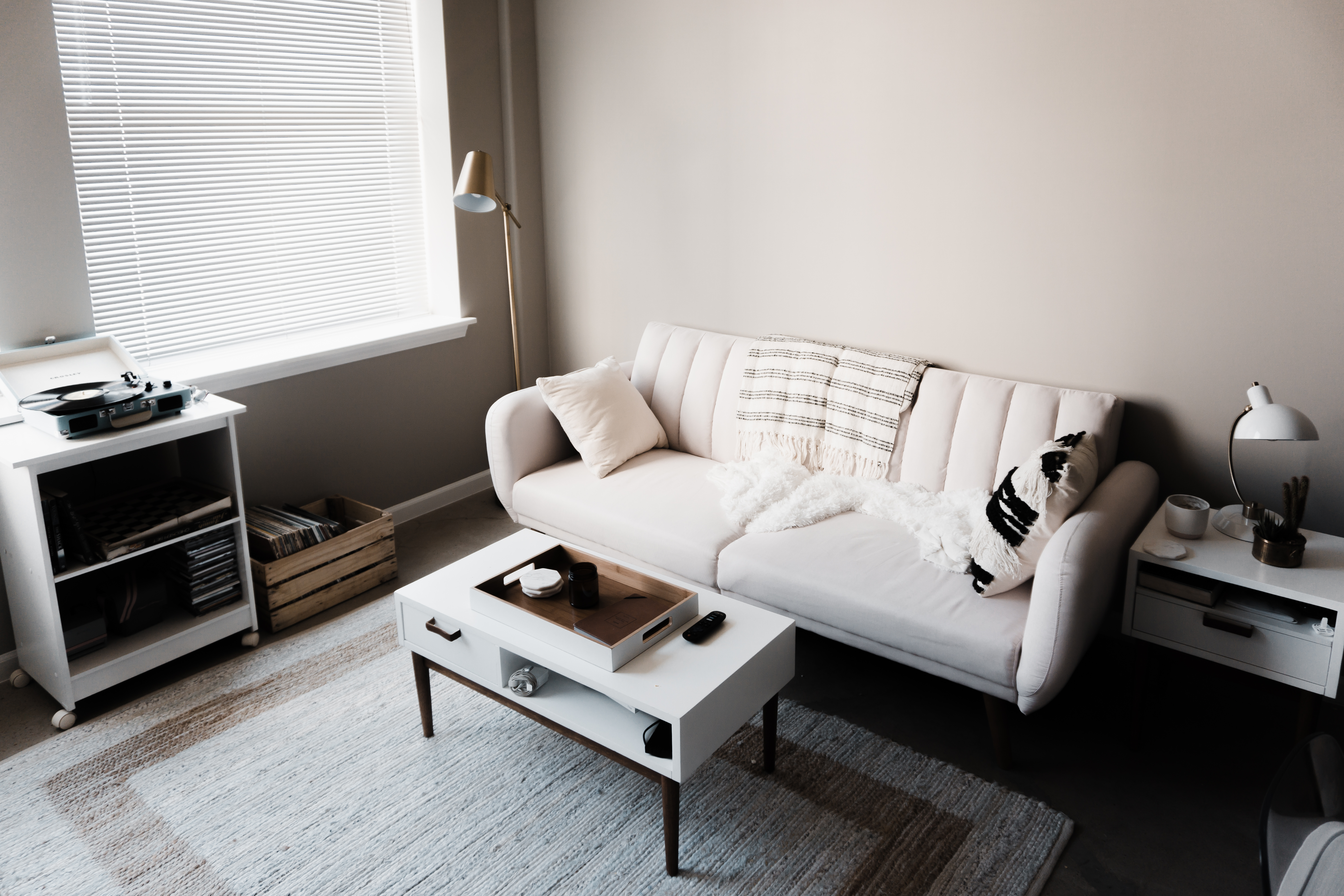 Living room interior of home with white sofa coffee table turn table and