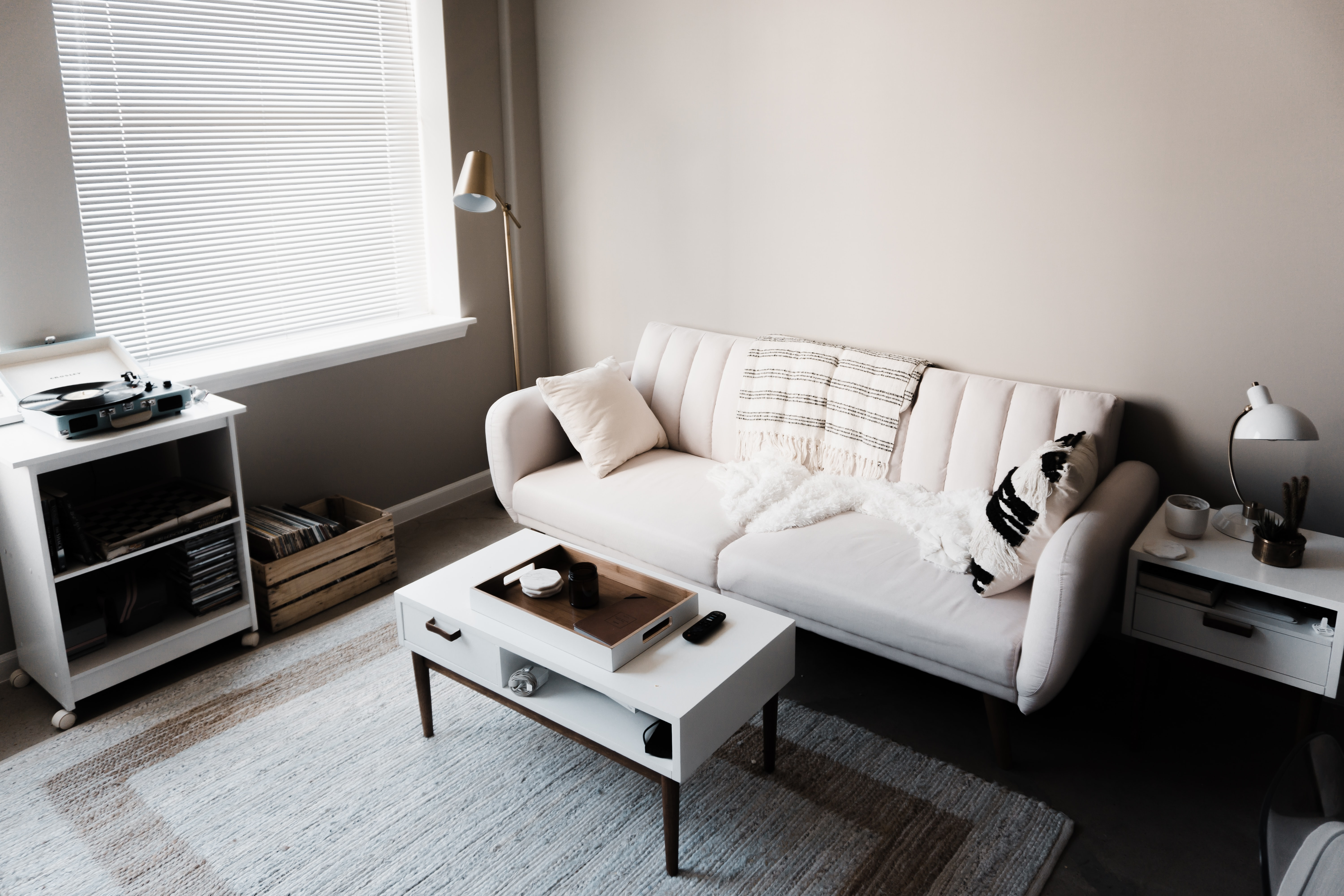 white couch in front of white wooden table