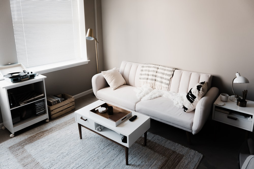 White Couch In Front Of White Wooden Table Photo Free Room Image On Unsplash