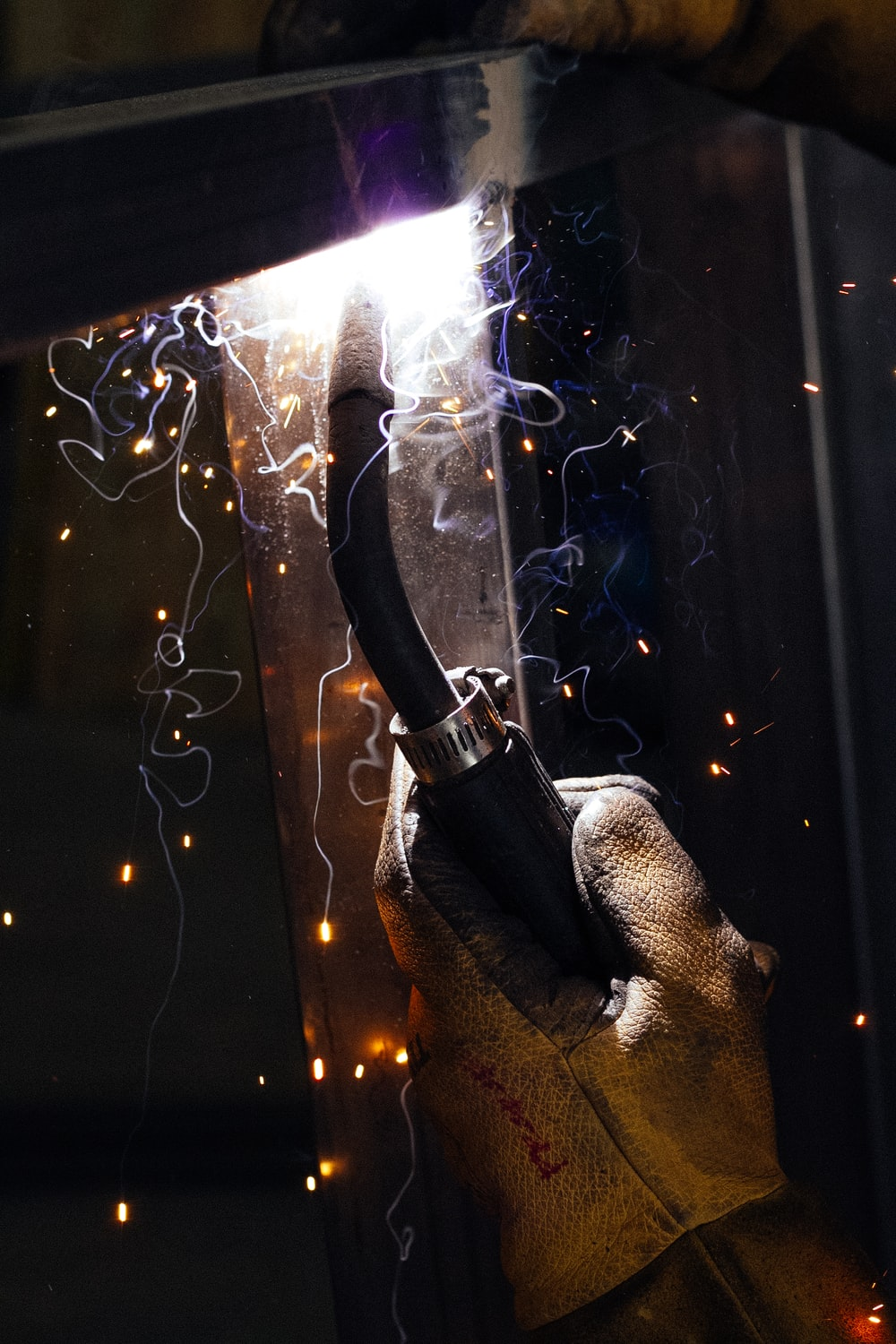 person holding cutting torch