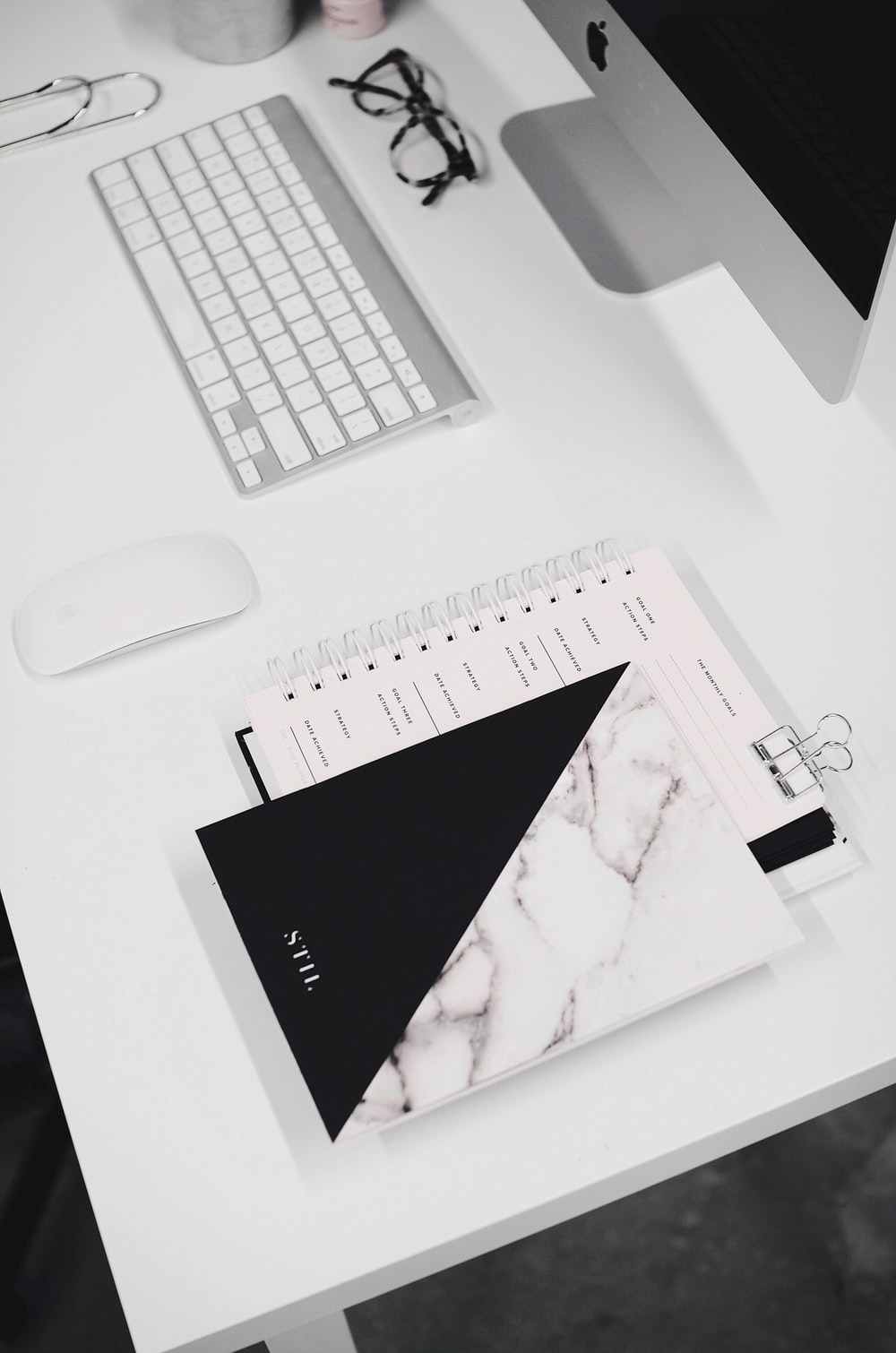 white and black notebook