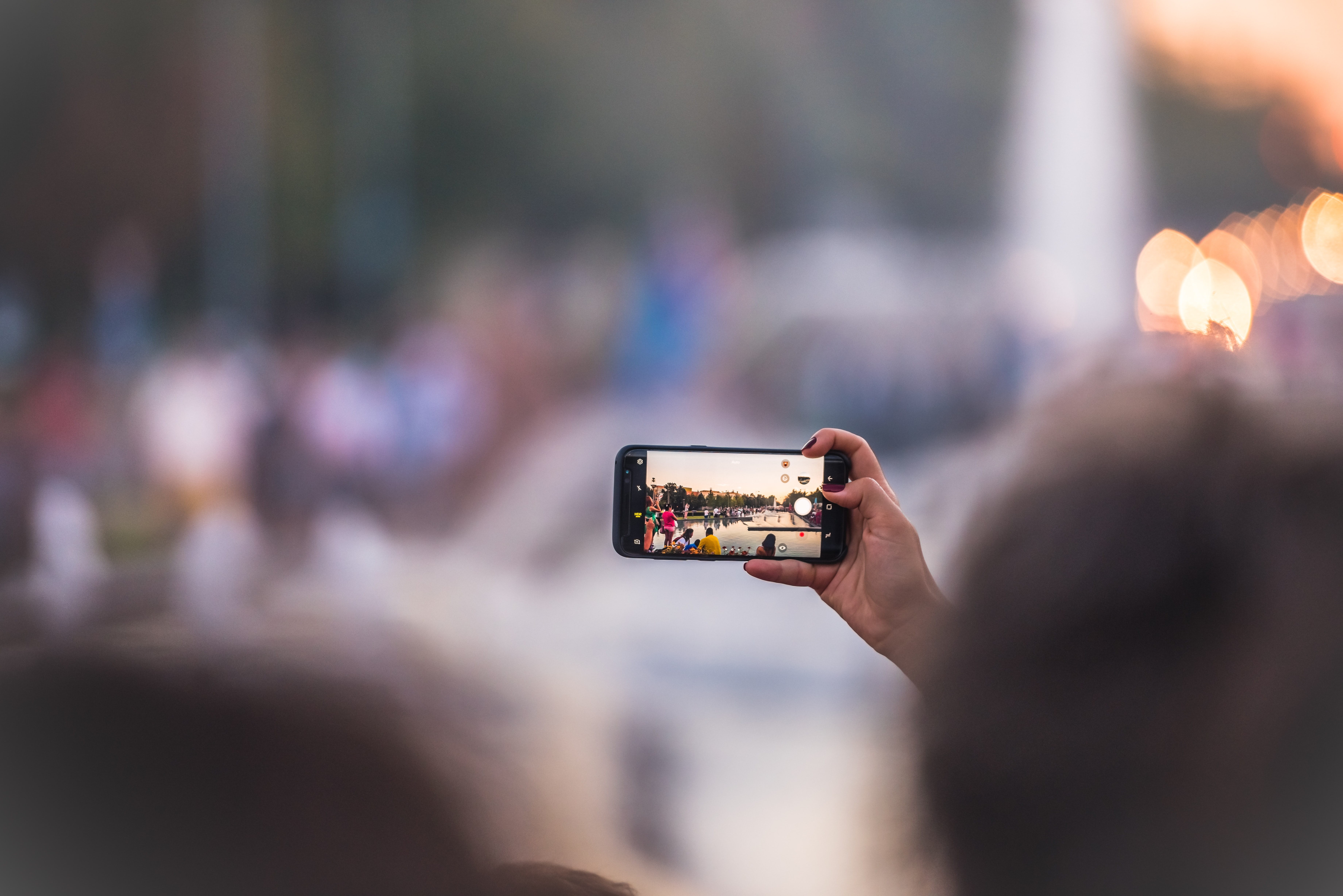 Person takes a photo of the crown on their iPhone