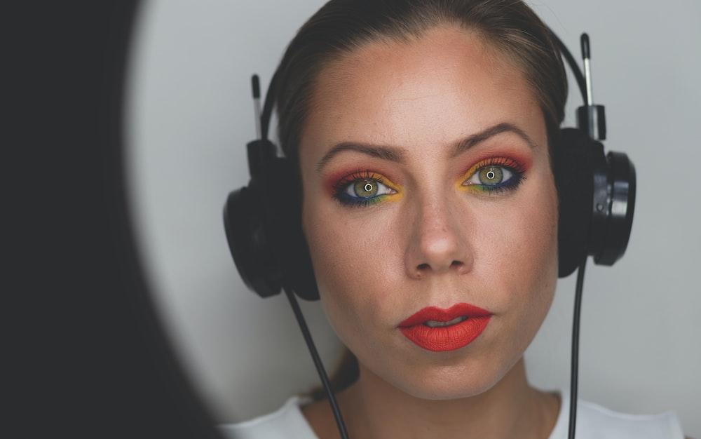 woman wearing black corded headphones
