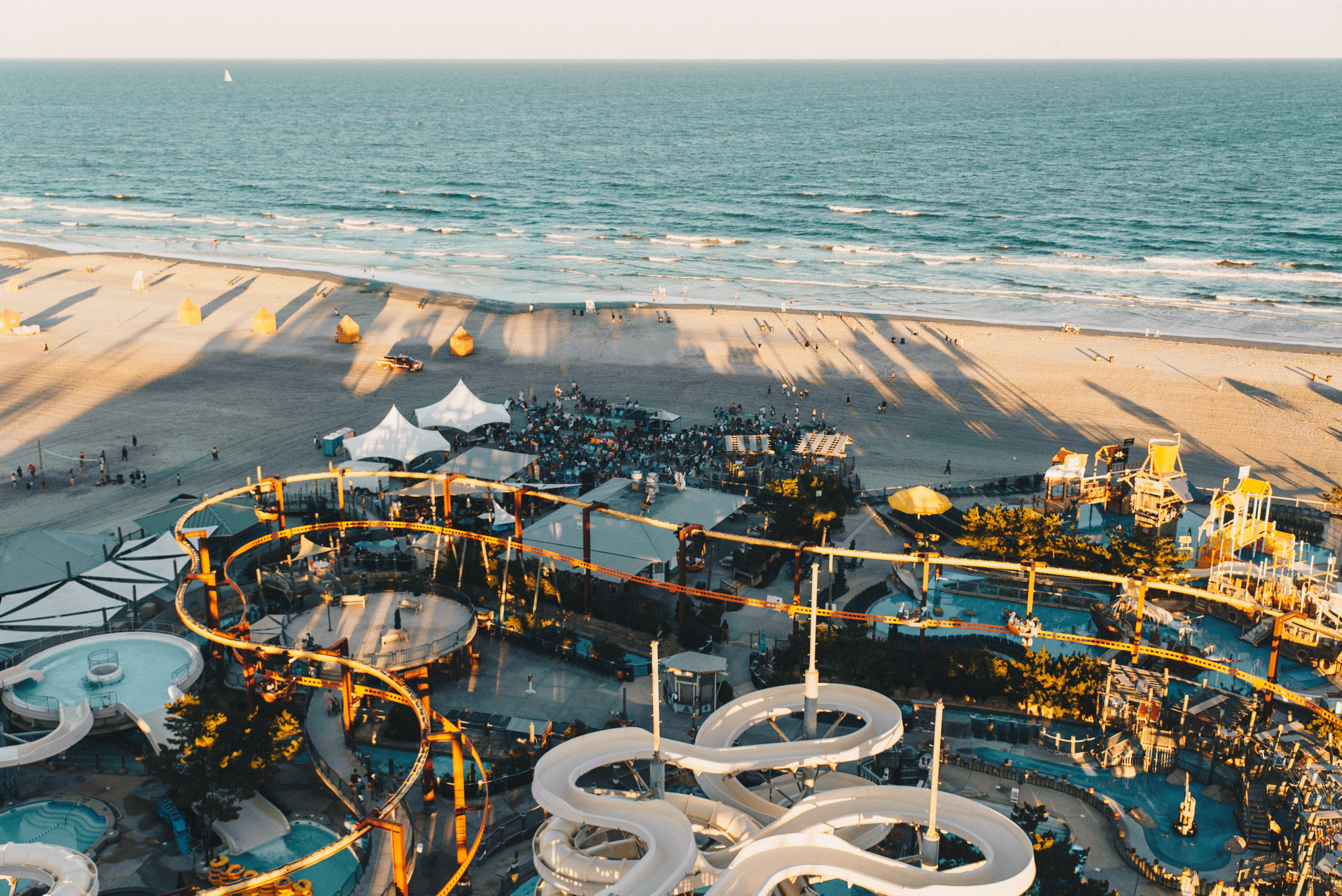 Drone view of a water park on a sandy beach at Morey's Piers & Beachfront Water Parks