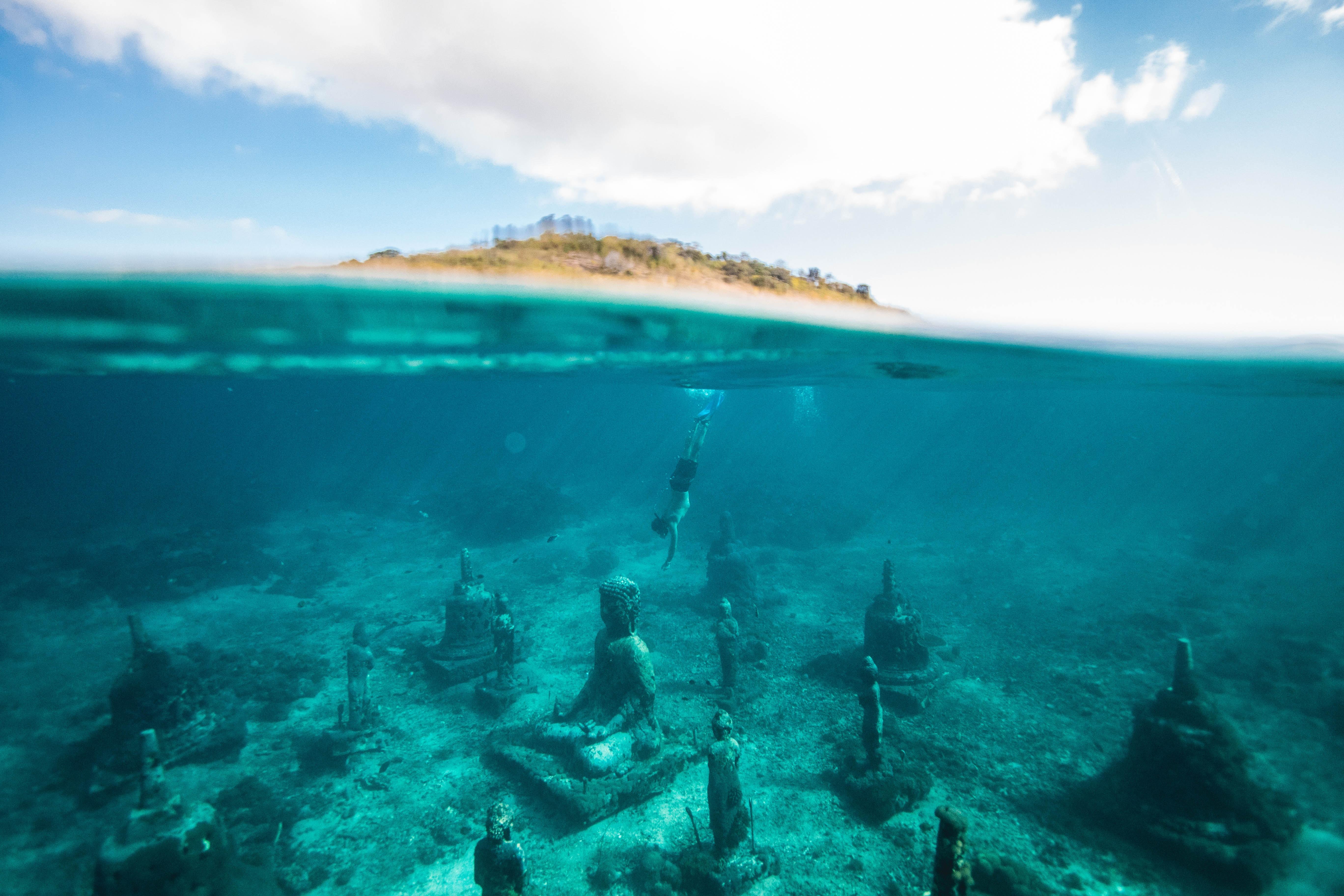 Sunken Buddha statue underwater