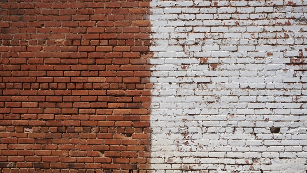 photo of white and brown bricked wall during daytime