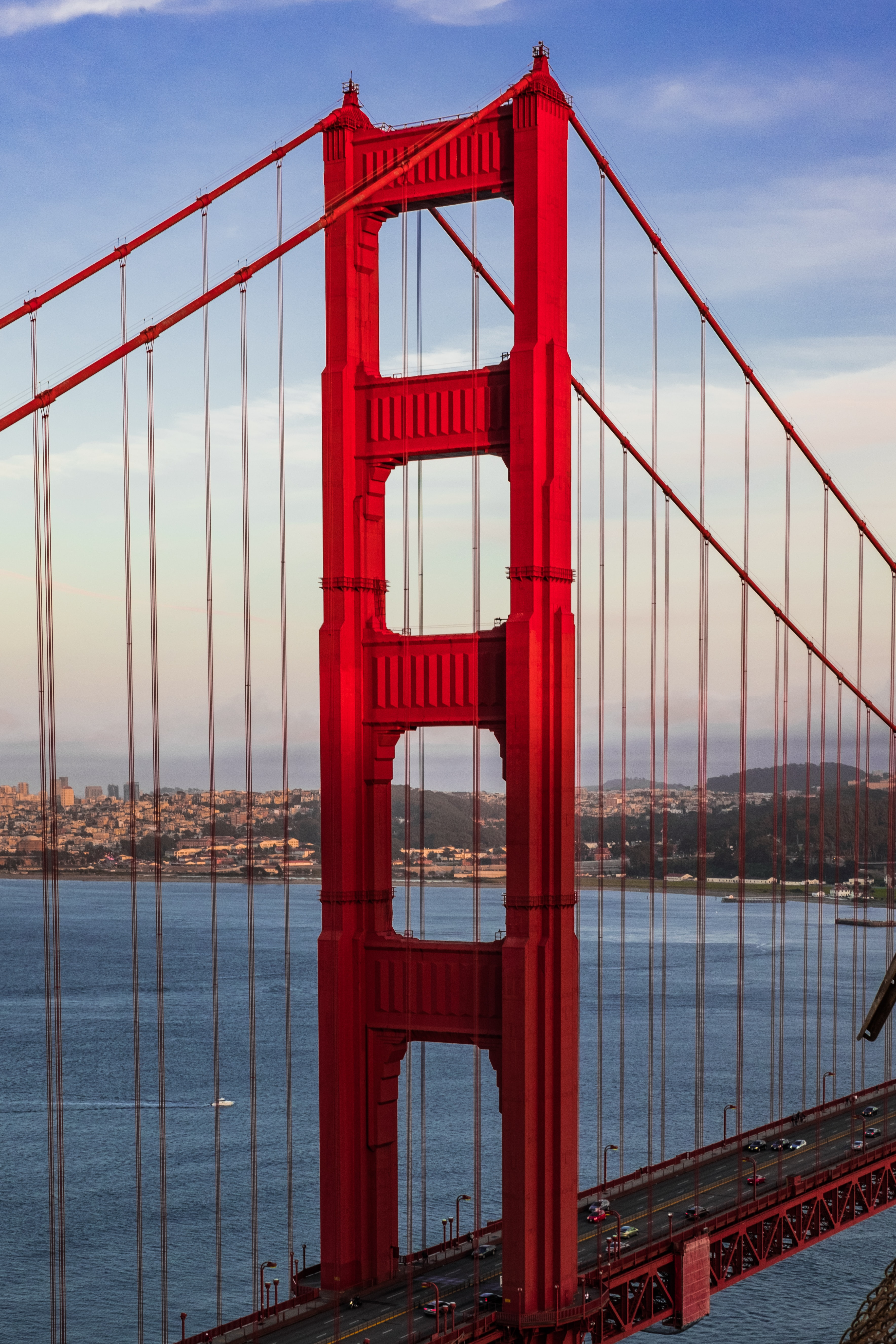 The Golden Gate Bridge in San Francisco in brilliant red with the coast in the background