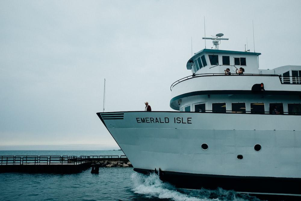 white Emerald Isle boat near dock at daytime