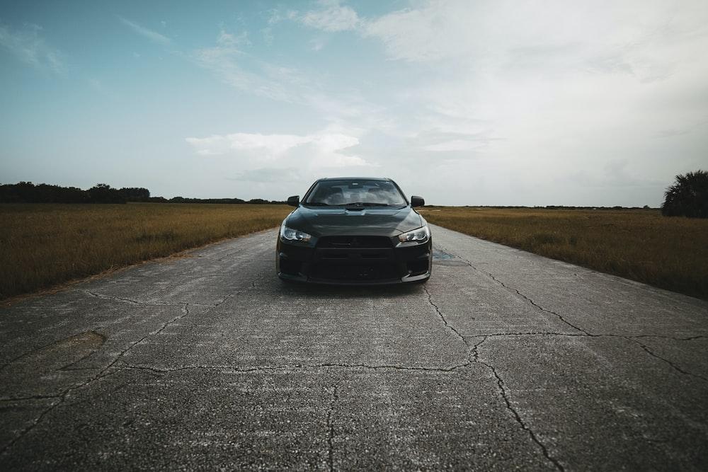 black car on concrete road