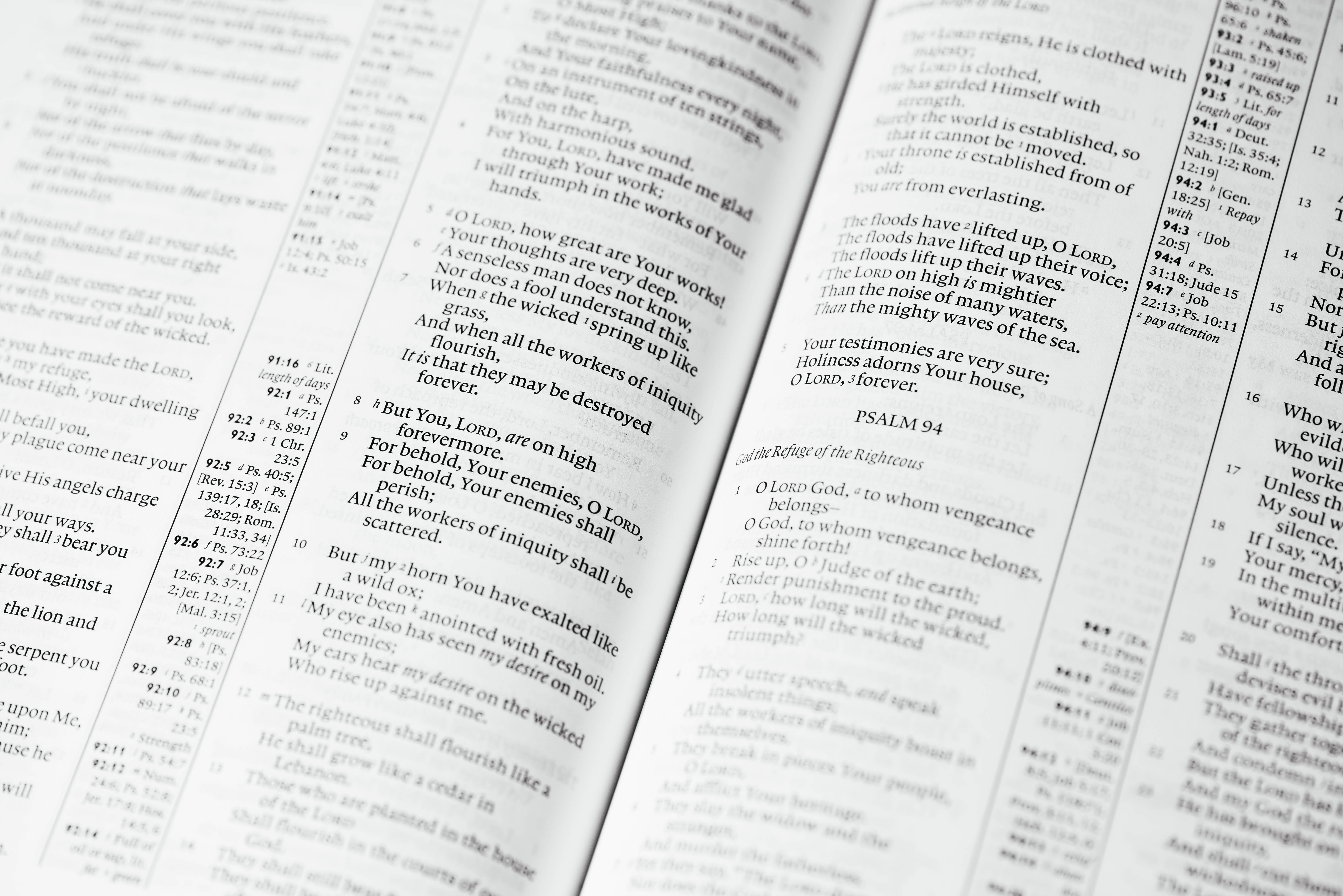 Black and white close up shot of verses in religious book