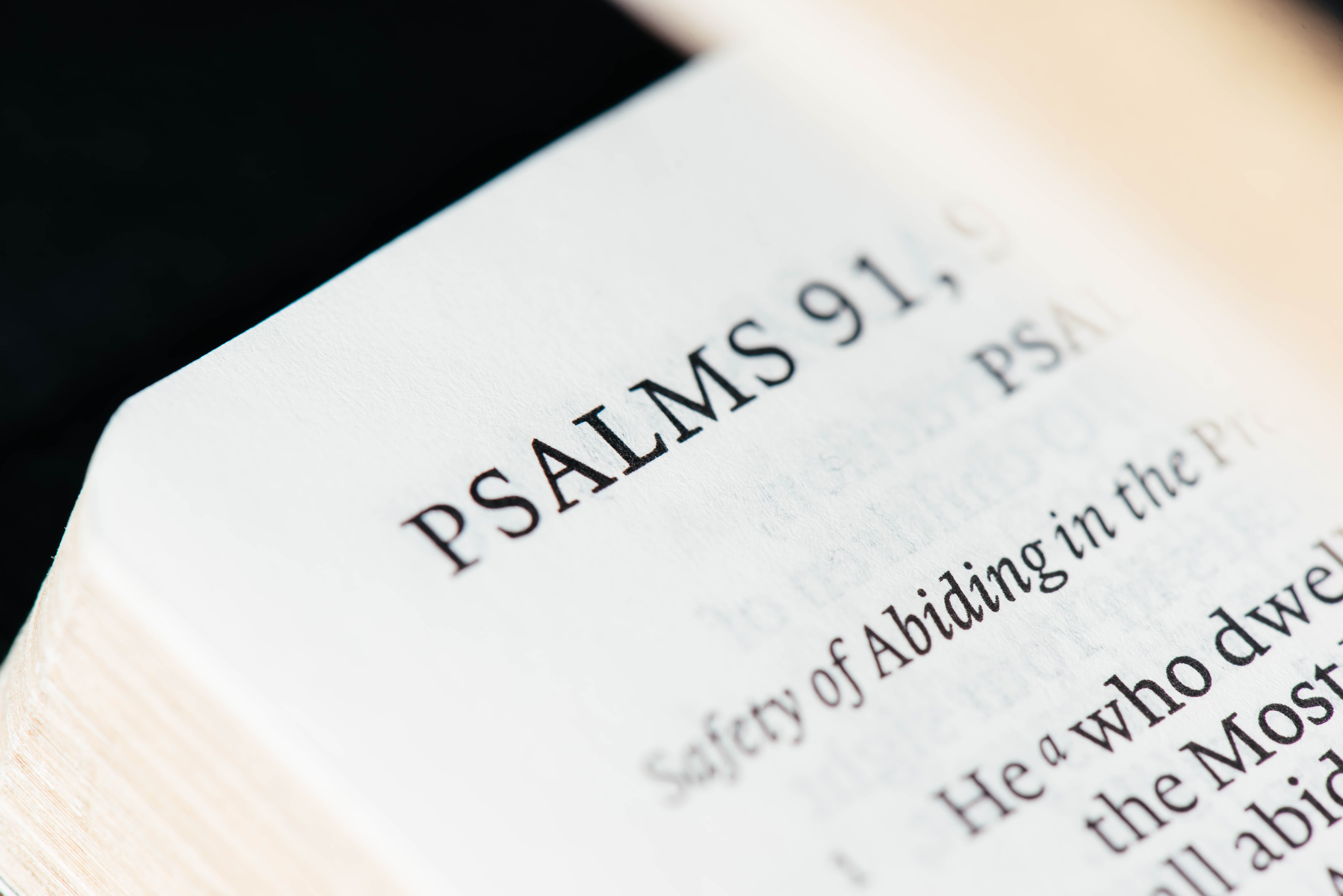A macro shot of Psalms 91, a religious text.
