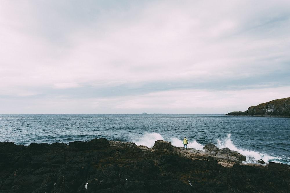 ocean waves near rock formation