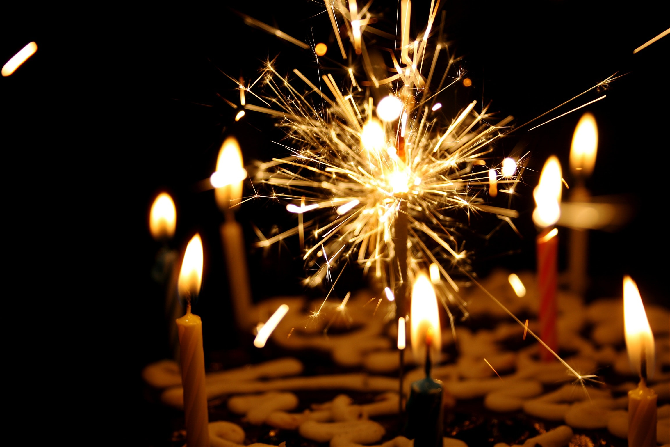A birthday cake with candles and sparklers