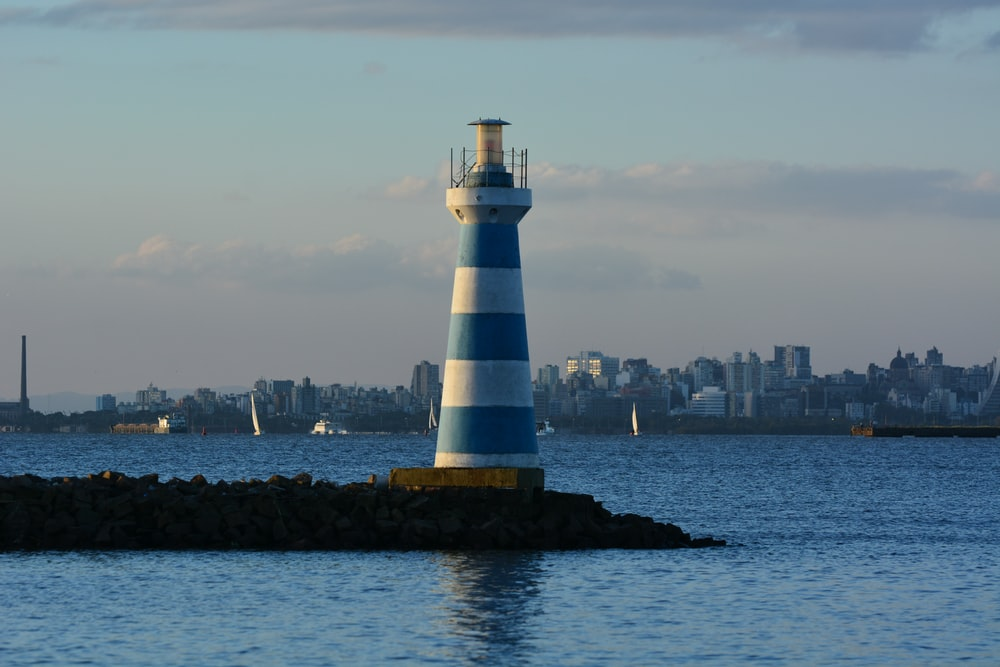 white and blue lighthouse photography