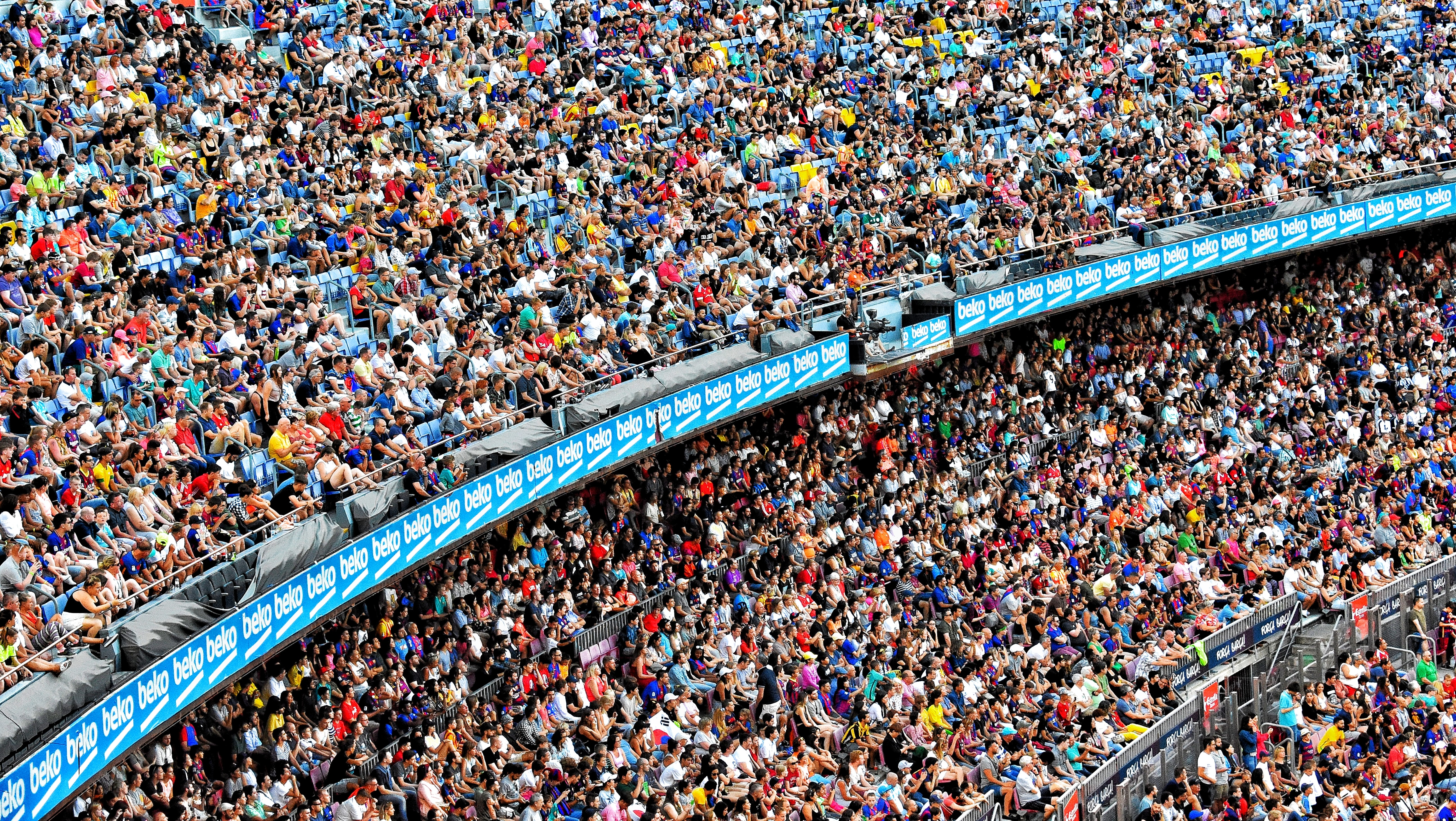 Aerial view of a crowd in a stadium during a match cheering