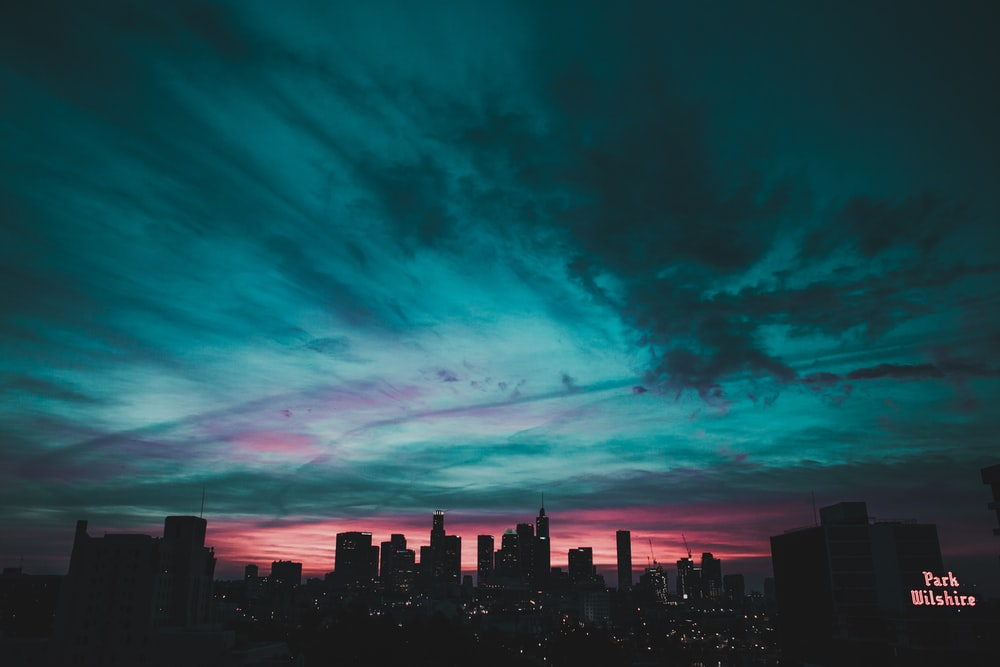 teal sky under city buildings
