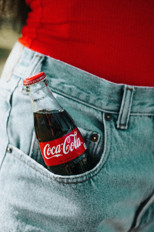 Coca-Cola glass bottle on pocket