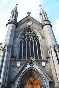 low angle photography of gray concrete cathedral taken at daytime