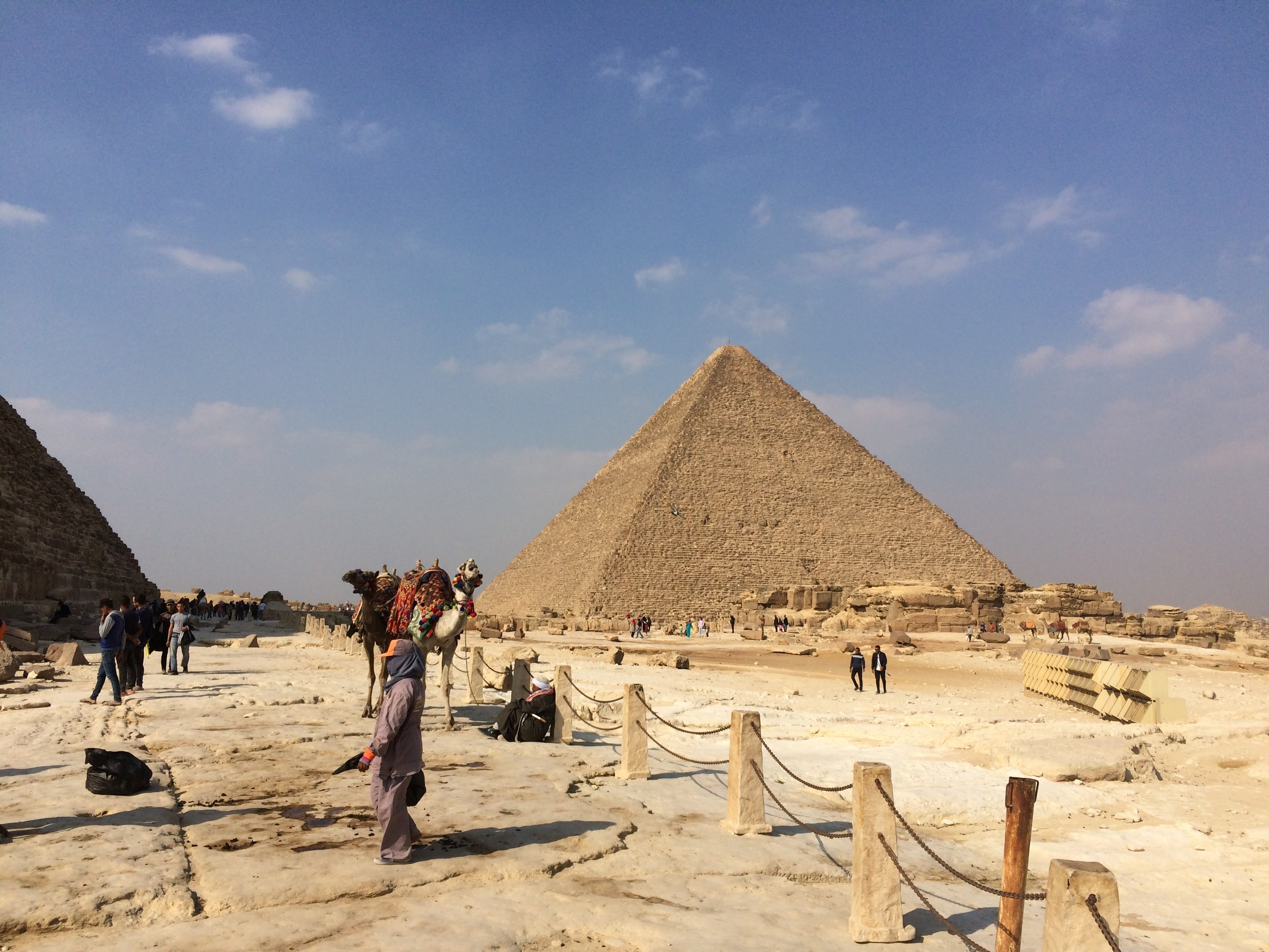 people standing near Pyramid of Giza under blue and white sky at during daytime