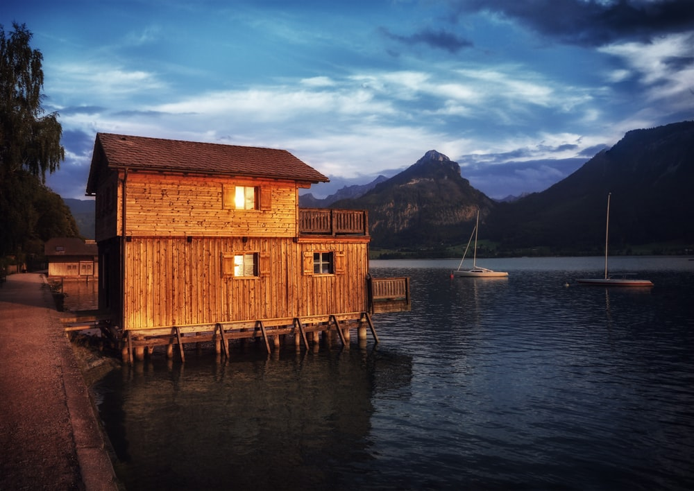 brown house near body of water