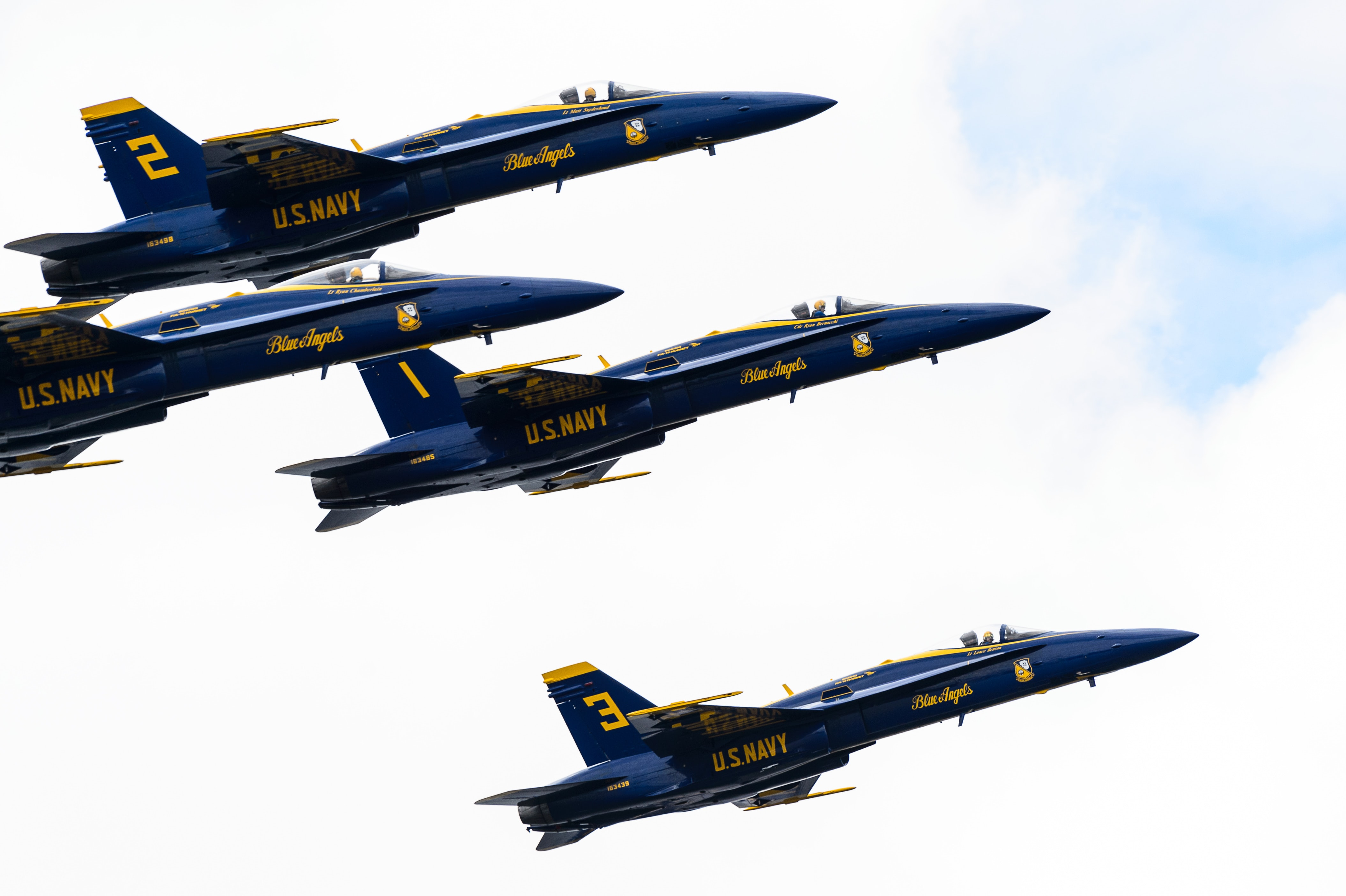 Side shot of the famous Blue Angels flying in formation.