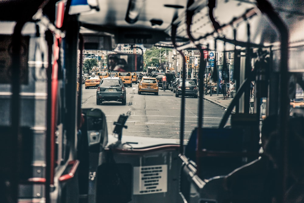 photo of road through bus windshield