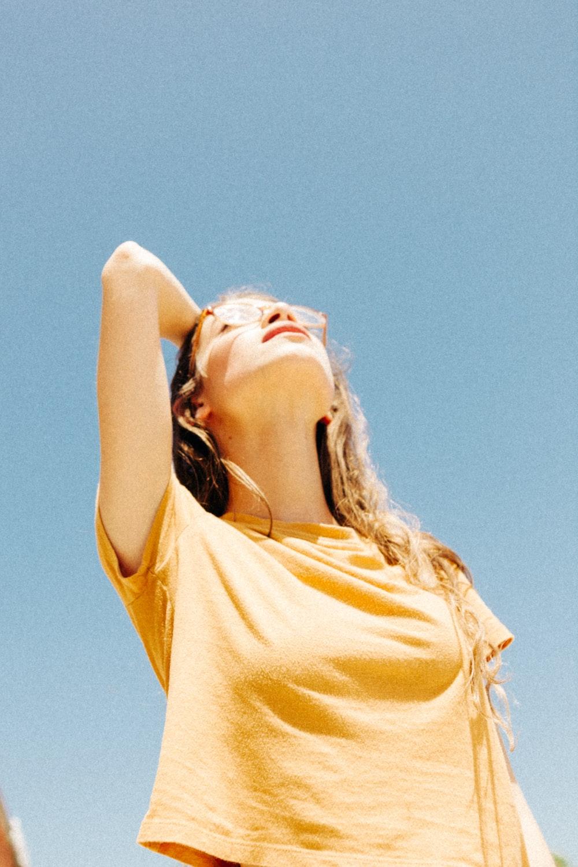 woman wearing yellow top during daytime