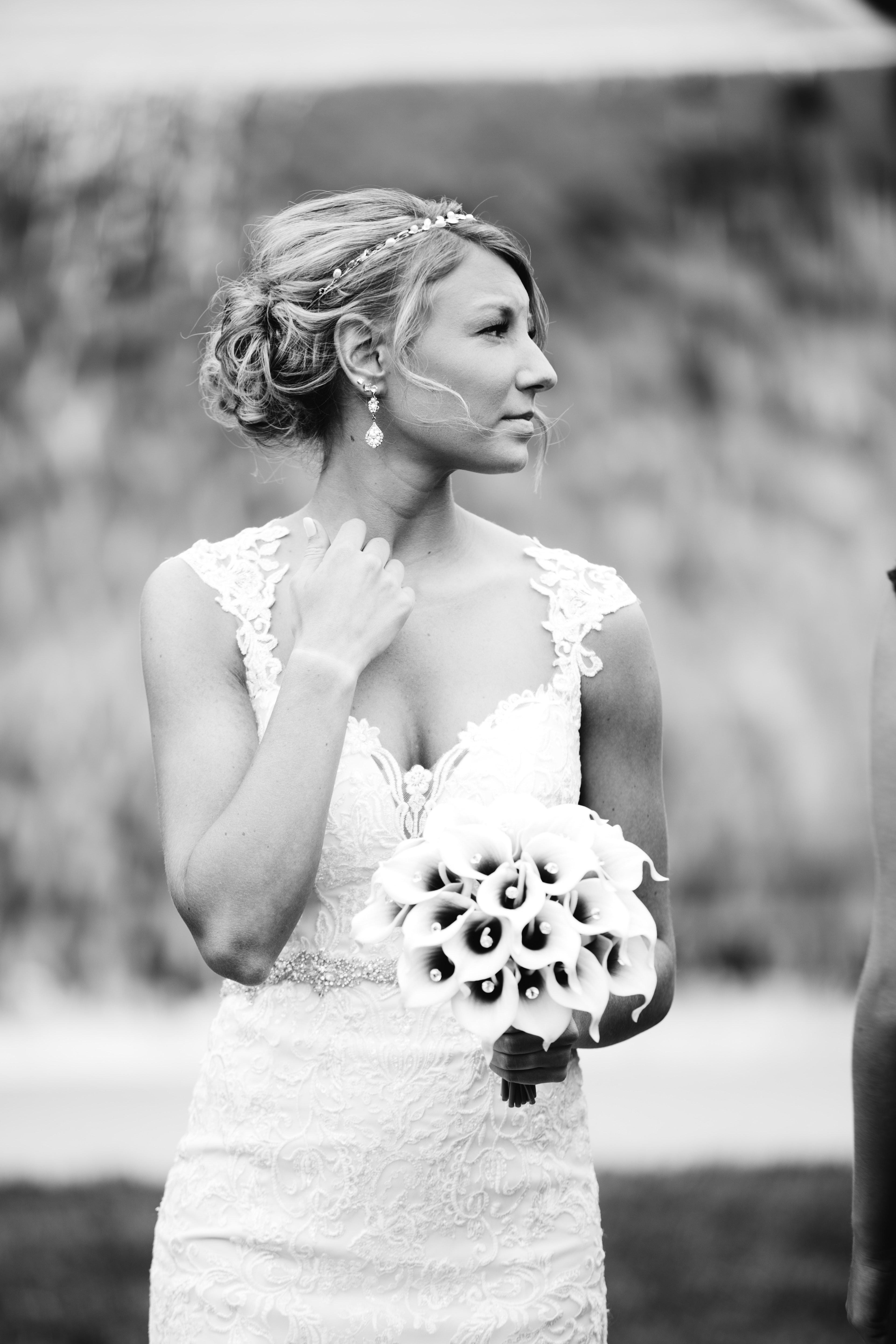Black and white shot of bride in wedding dress holding bouquet, Greater Des Moines Botanical Garden