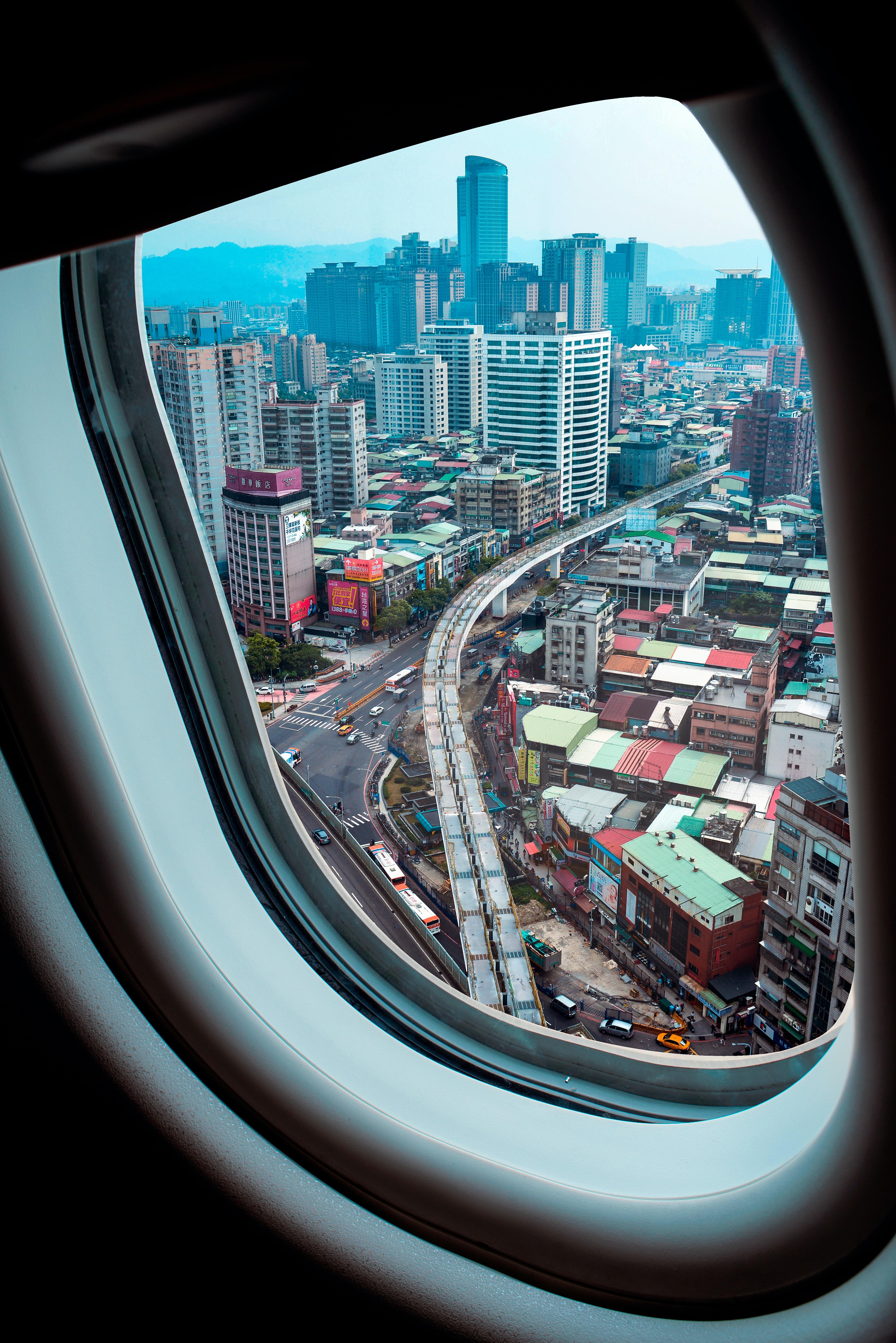 airplane window view of skyscraper