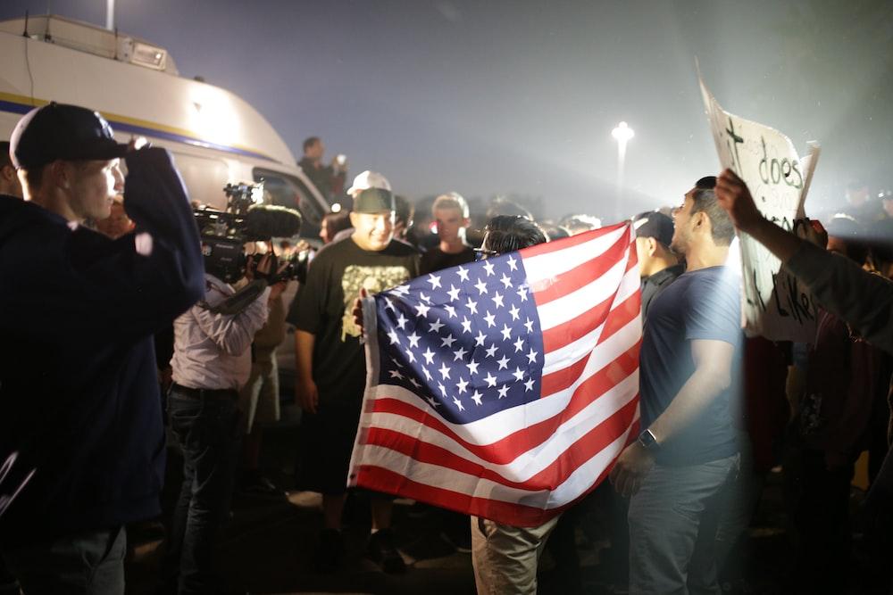 man holding American flag