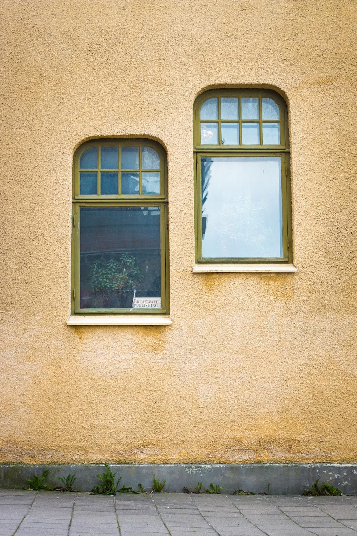 two gray frame glass windows